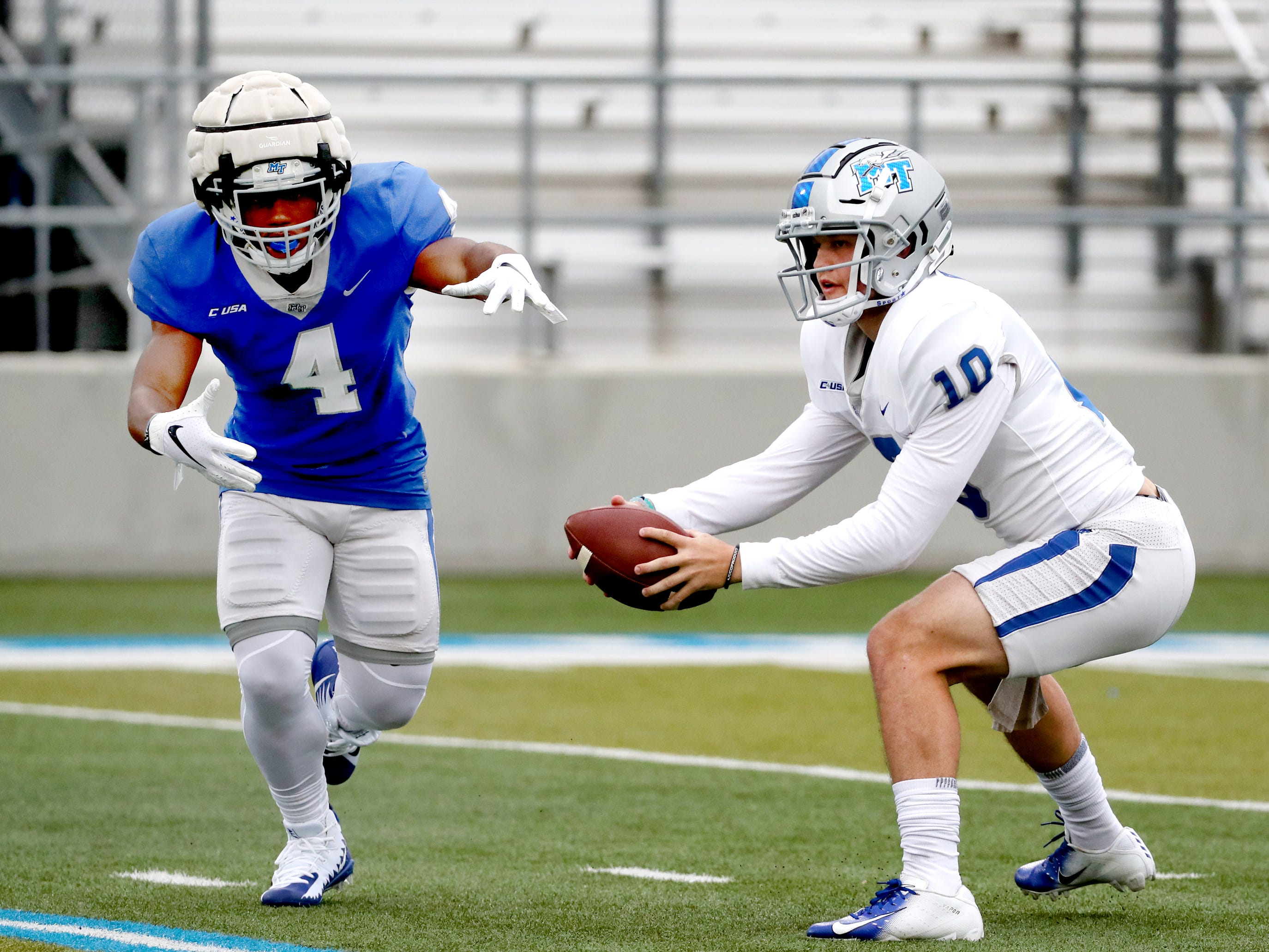 "MTSU's running back D'Monte Kemp (4) looks to take the hand-off as MTSU's quarterback Asher O'Hara (10) looks to pass the ball during MTSU's Blue-White Spring Finale held on Saturday April 13, 2019, at MTSU's Johnny ""Red"" Floyd Stadium."