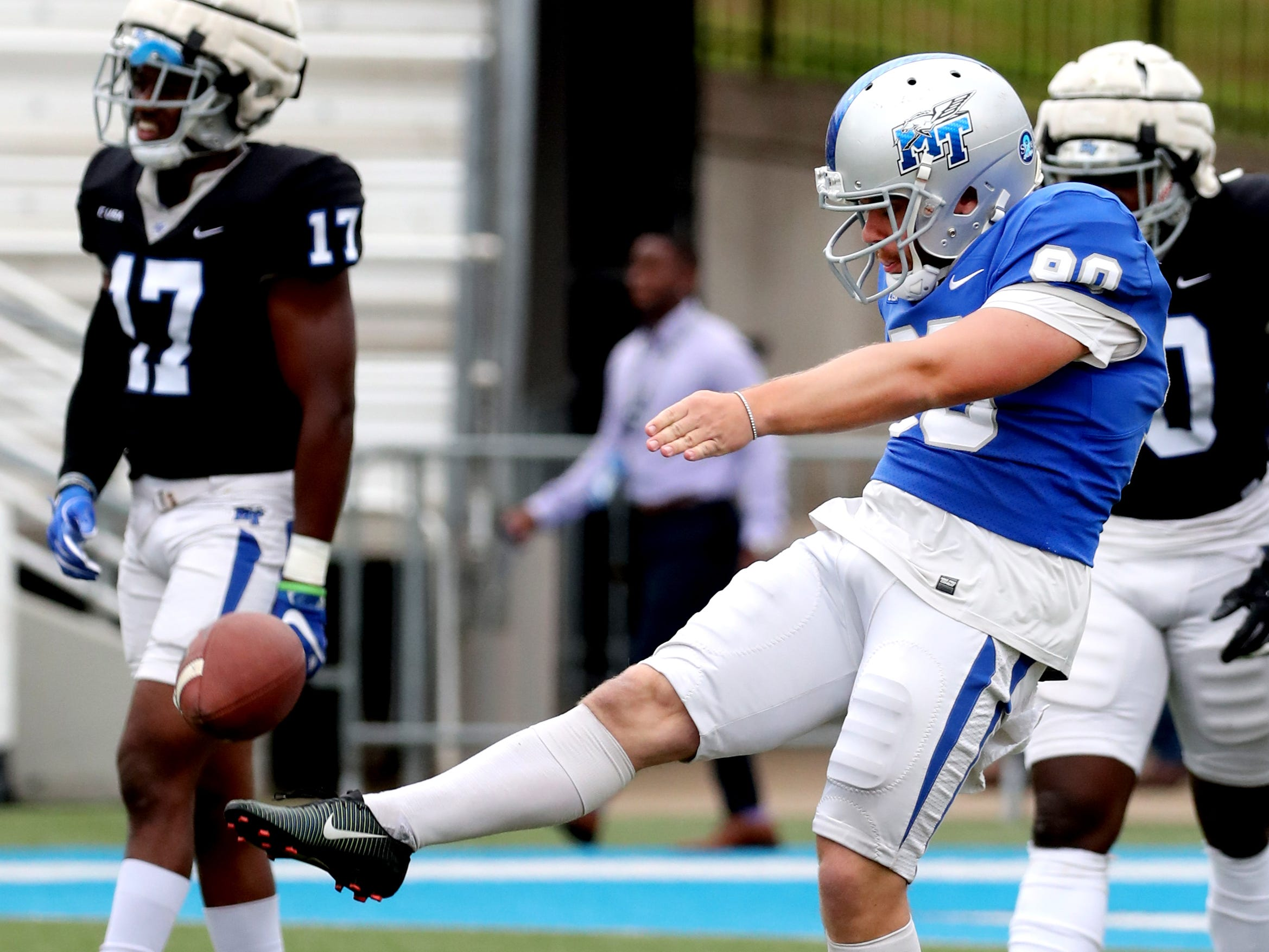 "MTSU's punter kicks the ball during Blue-White Spring Finale held on Saturday April 13, 2019, at MTSU's Johnny ""Red"" Floyd Stadium."