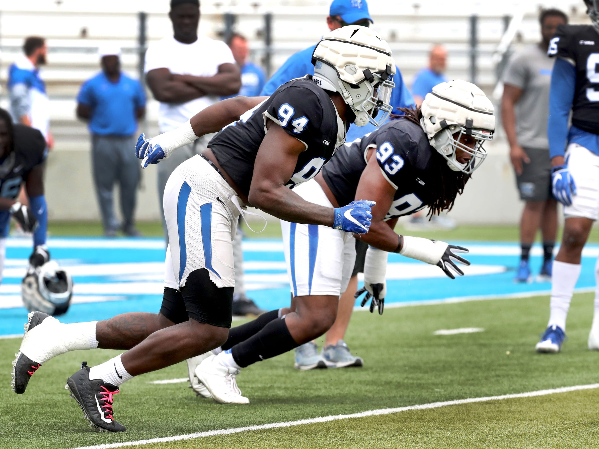 "MTSU's defensive end Tyshun Render (94) and MTSU's defensive tackle Malik Manciel (93) run through a drill during MTSU's Blue-White Spring Finale held on Saturday April 13, 2019, at MTSU's Johnny ""Red"" Floyd Stadium."