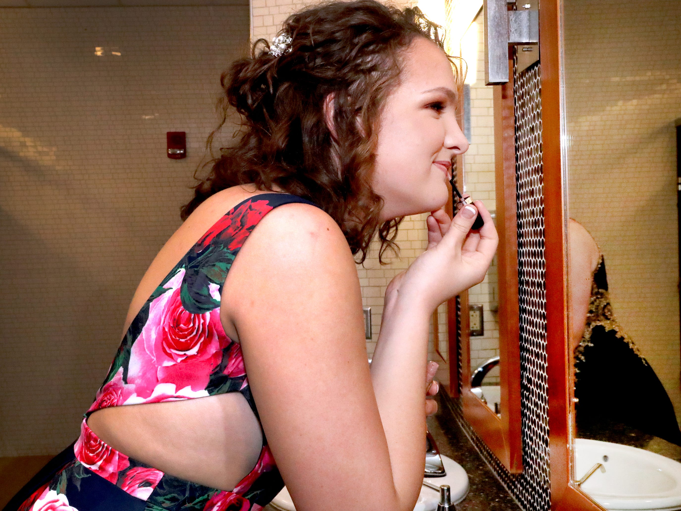 Lexie Ludlam primps in the mirror of the ladies room at Blackman's prom held on Friday April 12, 2019, at MTSU.