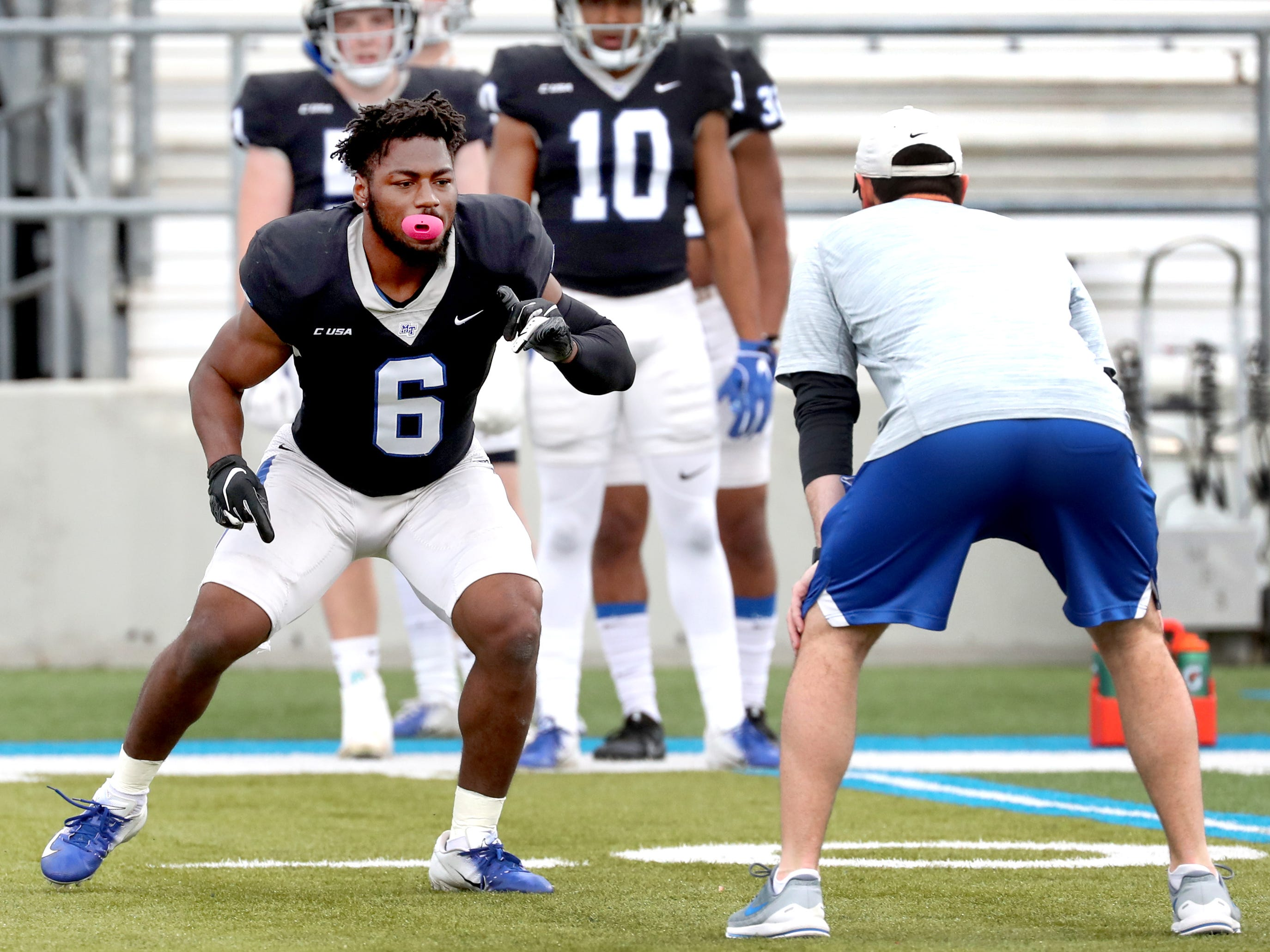"MTSU's linebacker Khalil Brooks (6) runs through drills during MTSU's Blue-White Spring Finale held on Saturday April 13, 2019, at MTSU's Johnny ""Red"" Floyd Stadium."