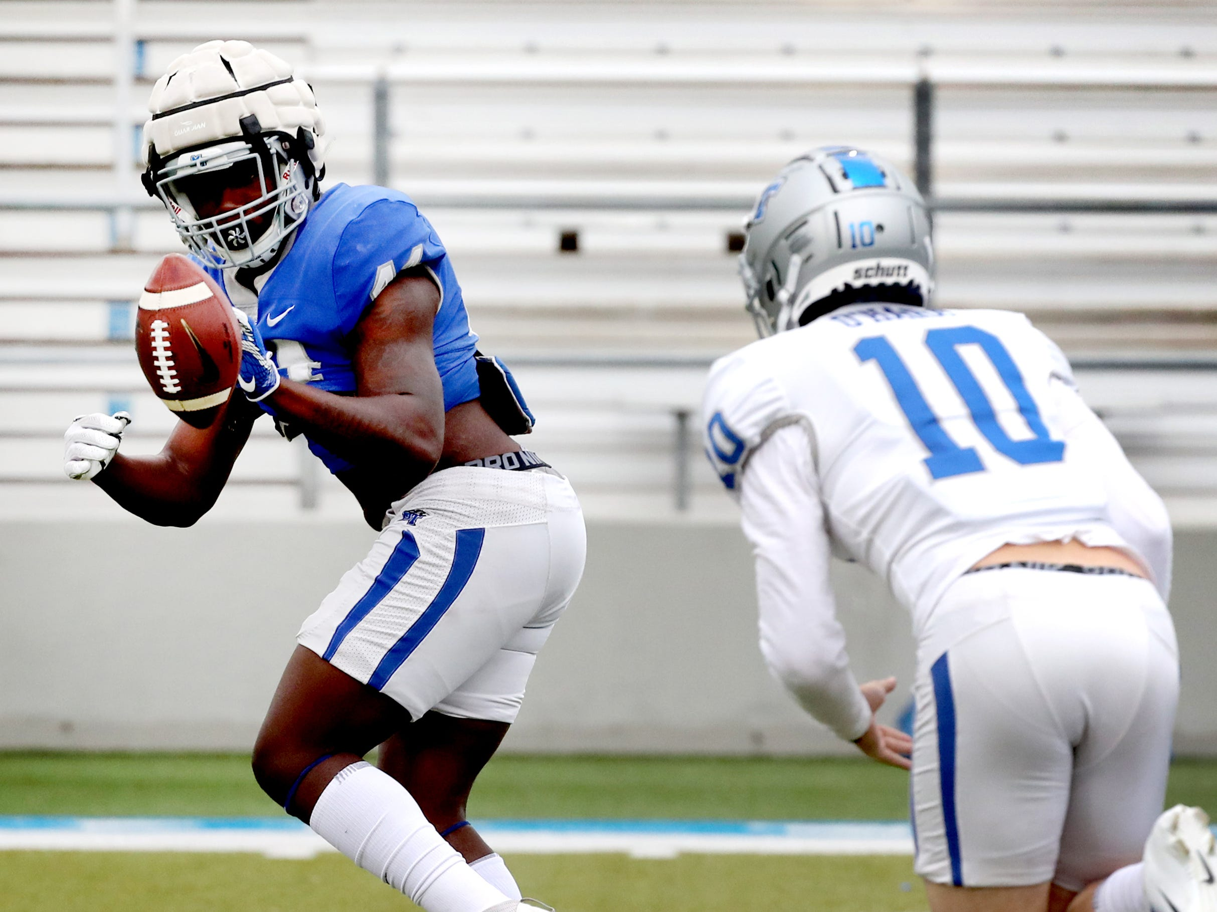 "MTSU's quarterback Asher O'Hara (10) tosses the ball to MTSU's running back Chaton Mobley (44) during MTSU's Blue-White Spring Finale held on Saturday April 13, 2019, at MTSU's Johnny ""Red"" Floyd Stadium."