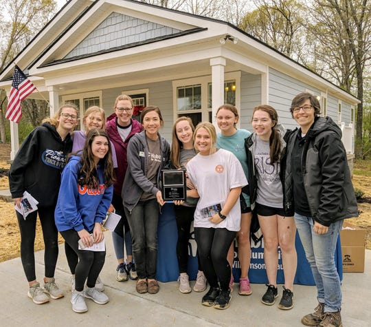 Students from the Franklin High School Habitat High Club receive their plaque at Dowell's dedication on Saturday, April 13, 2019.