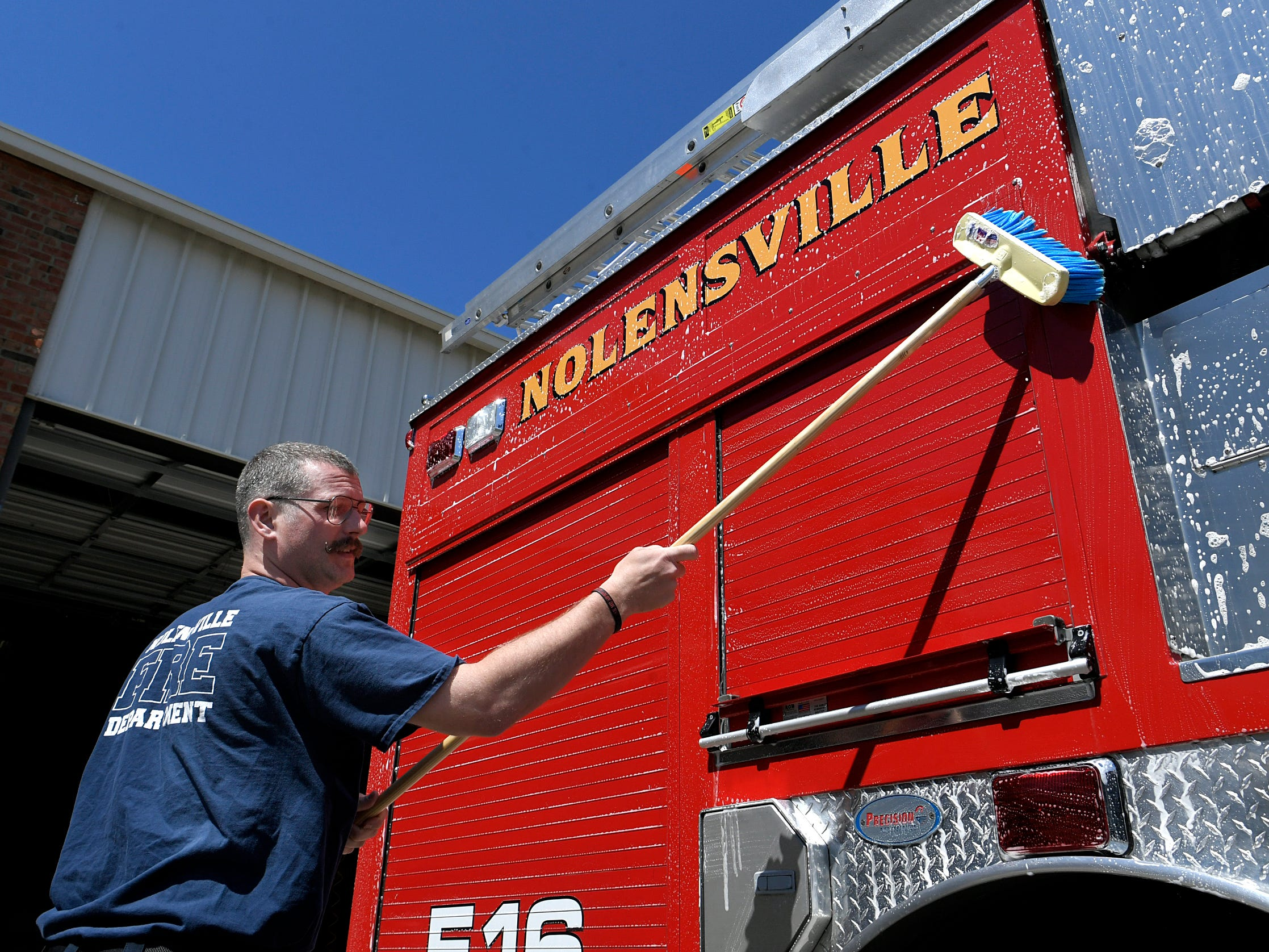 Nolensville Volunteer Fire Department member Daron Standifird washes the department's firetruck between calls on Monday, April 15, 2019.