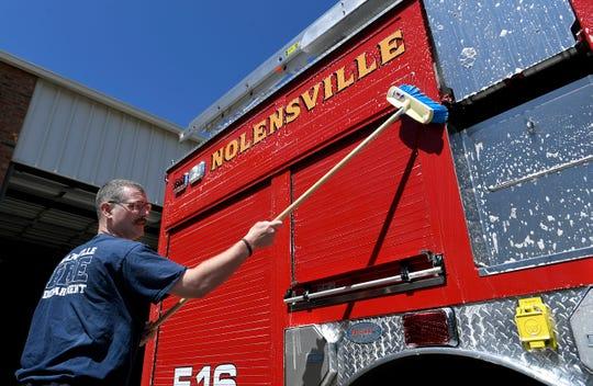 Nolensville Volunteer Fire Department member Daron Standifird washes the department's firetruck between calls on Monday, April 15, 2019.
