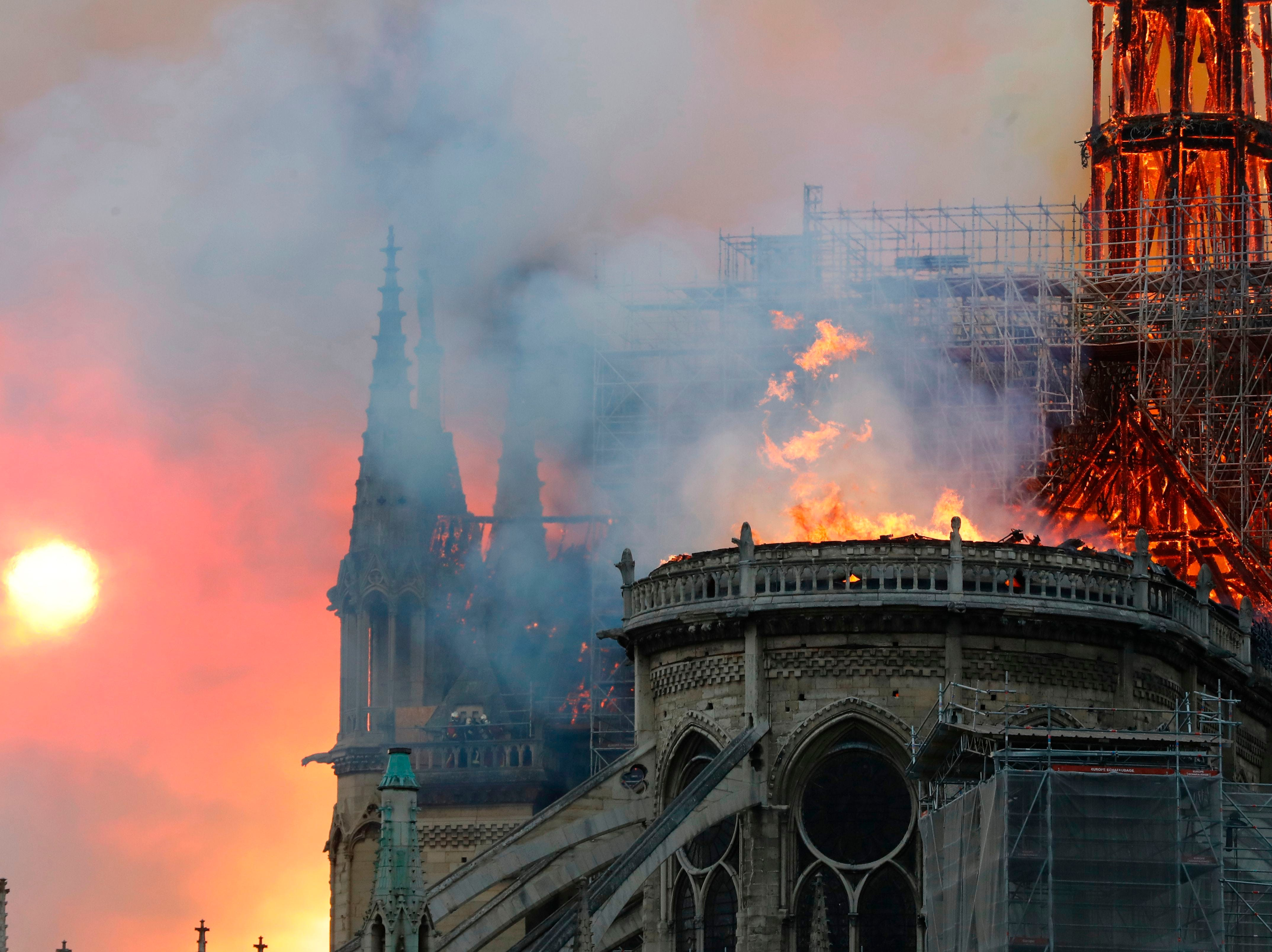 Smoke billows as flames destroy the roof of the landmark Notre-Dame Cathedral in central Paris on April 15, 2019.