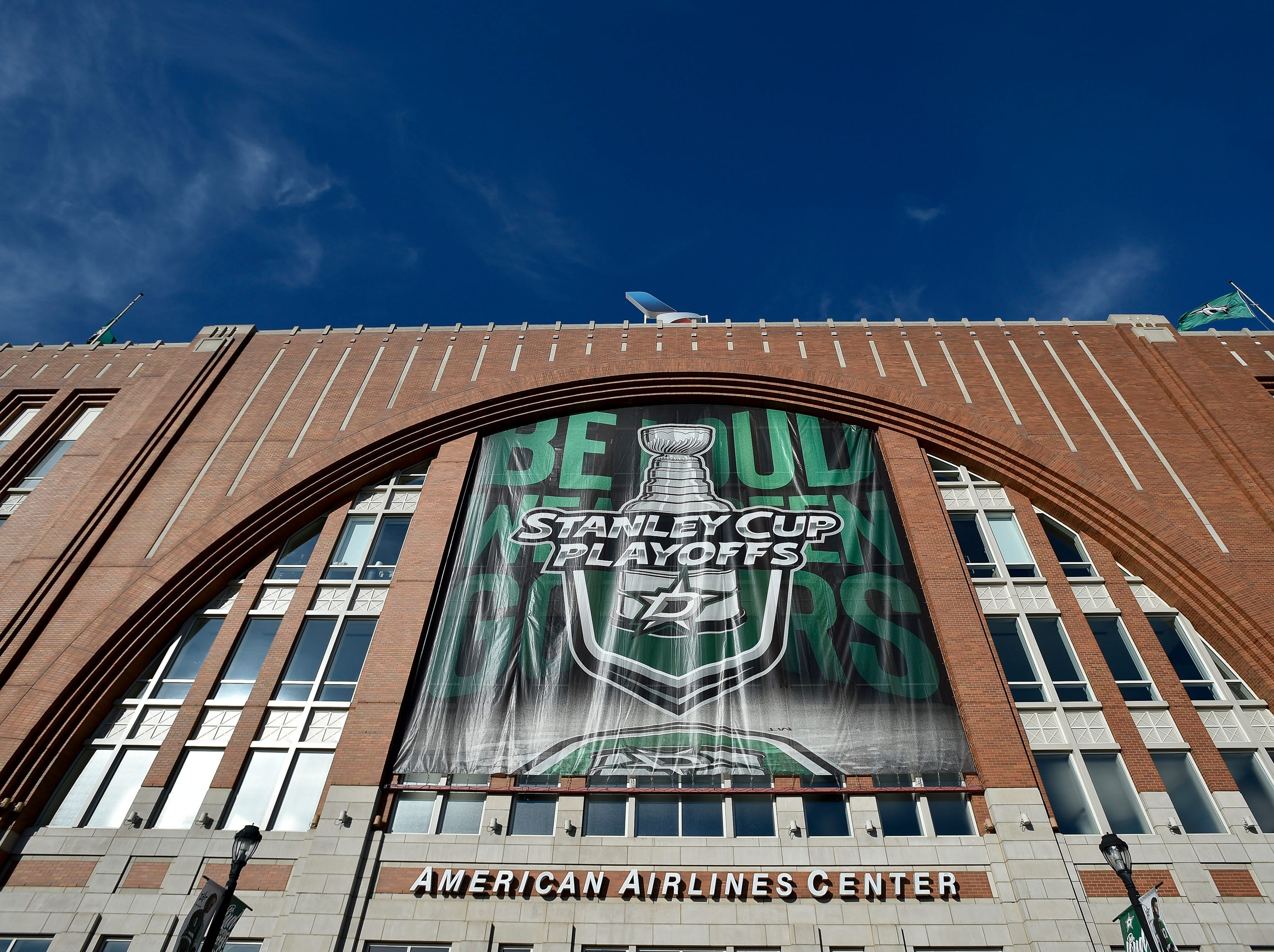 A playoffs banner is seen on the exterior before the divisional semifinal game between the Dallas Stars and the Nashville Predators at the American Airlines Center in Dallas, Texas., Monday, April 15, 2019.
