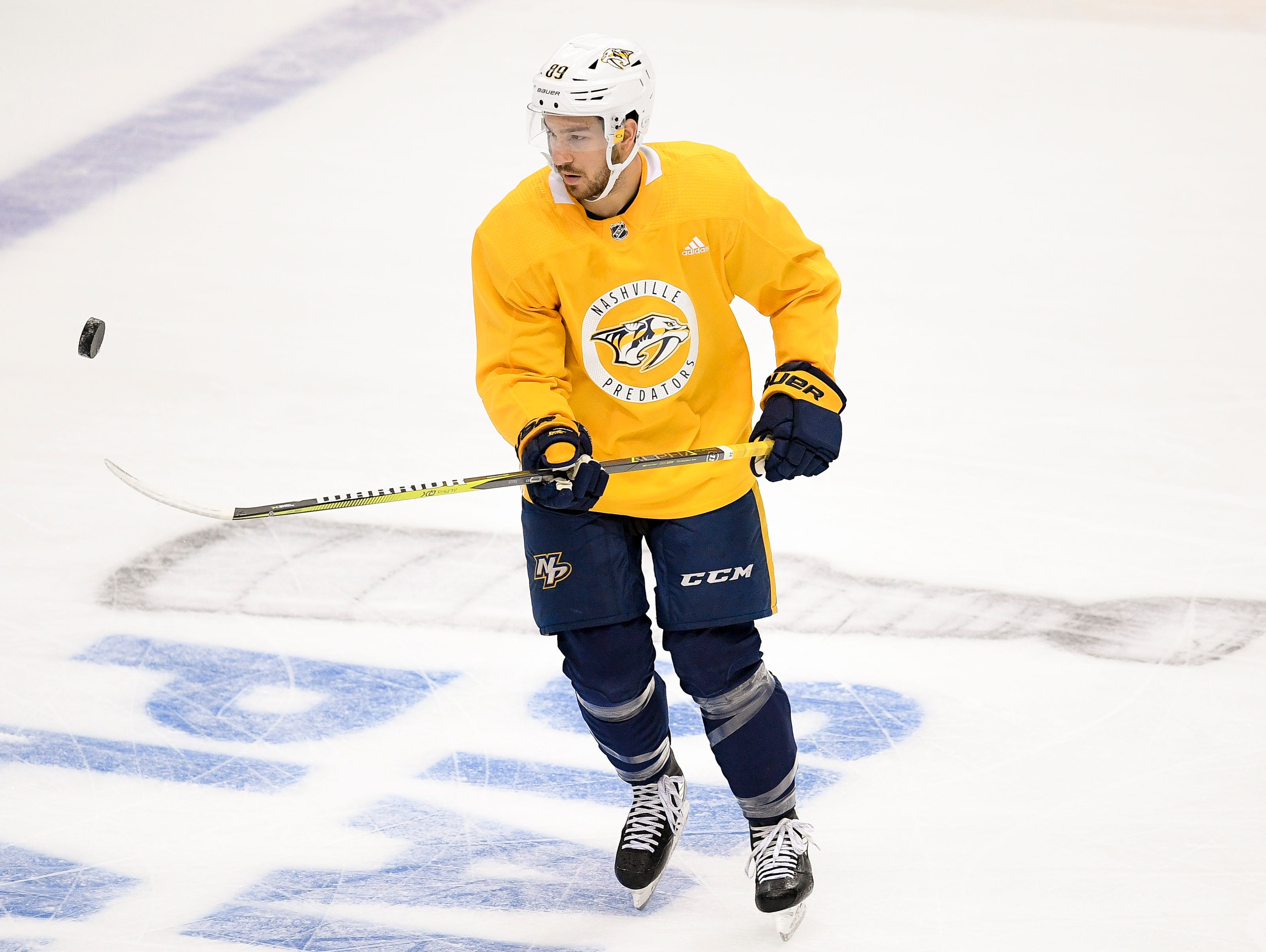 Nashville Predators center Frederick Gaudreau (89) flips a puck during practice before the divisional semifinal game at the American Airlines Center in Dallas, Texas., Monday, April 15, 2019.