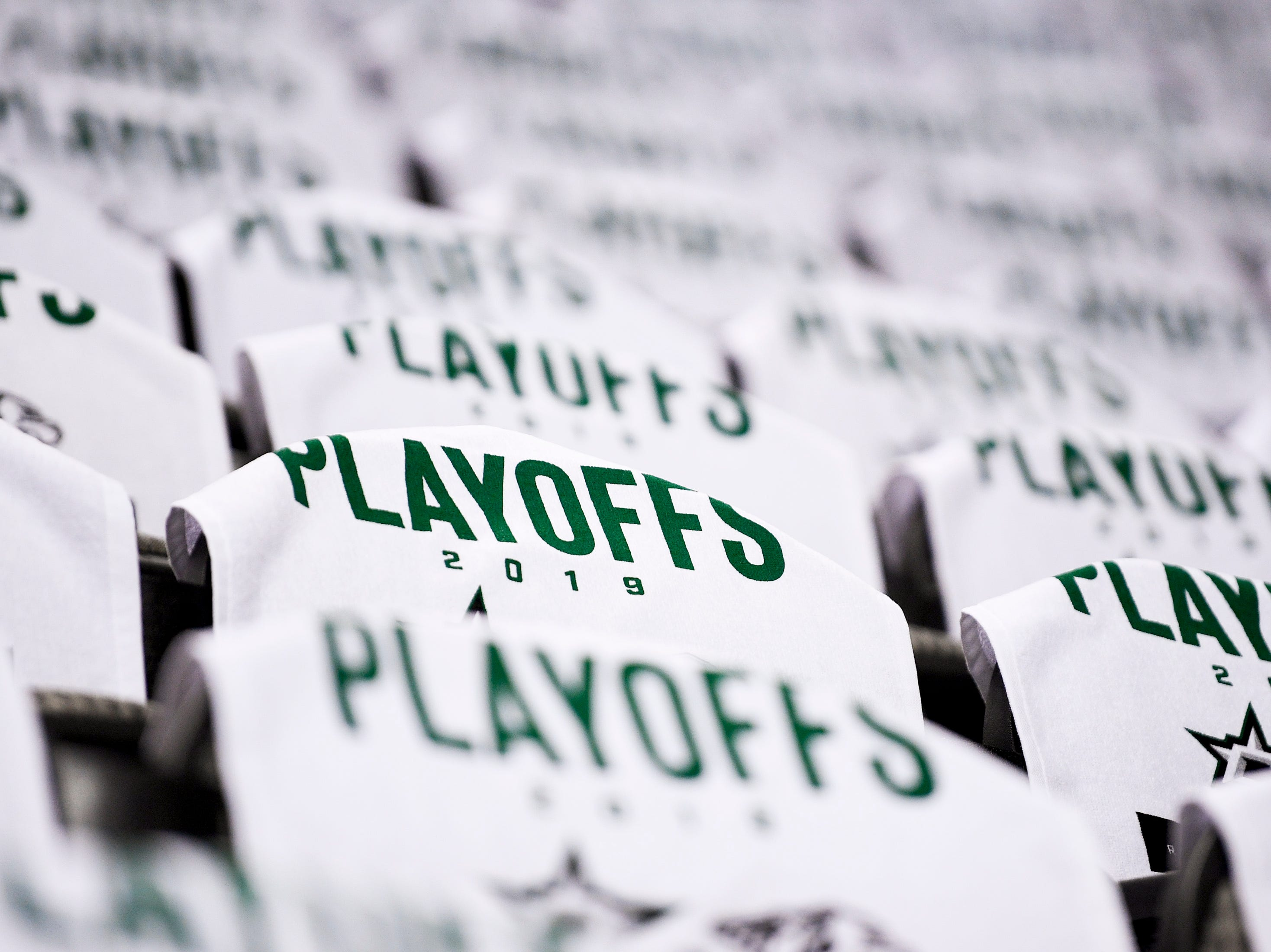 Souvenir towels sit on seats before the divisional semifinal game between the Nashville Predators and the Dallas Stars at the American Airlines Center in Dallas, Texas., Monday, April 15, 2019.