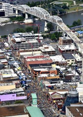 Crowds flock to downtown Nashville and Lower Broadway June 11, 2017, for a busy night on the town with the CMA Music Festival and Game 6 of the Stanley Cup Finals.