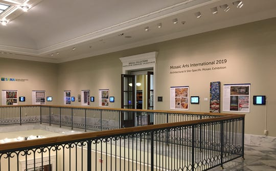 "Installation view of ""The Mosaic Arts International 2019 Architectural & Site-Specific Mosaic Exhibition"" at the Downtown Nashville Public Library Mezzanine Gallery."