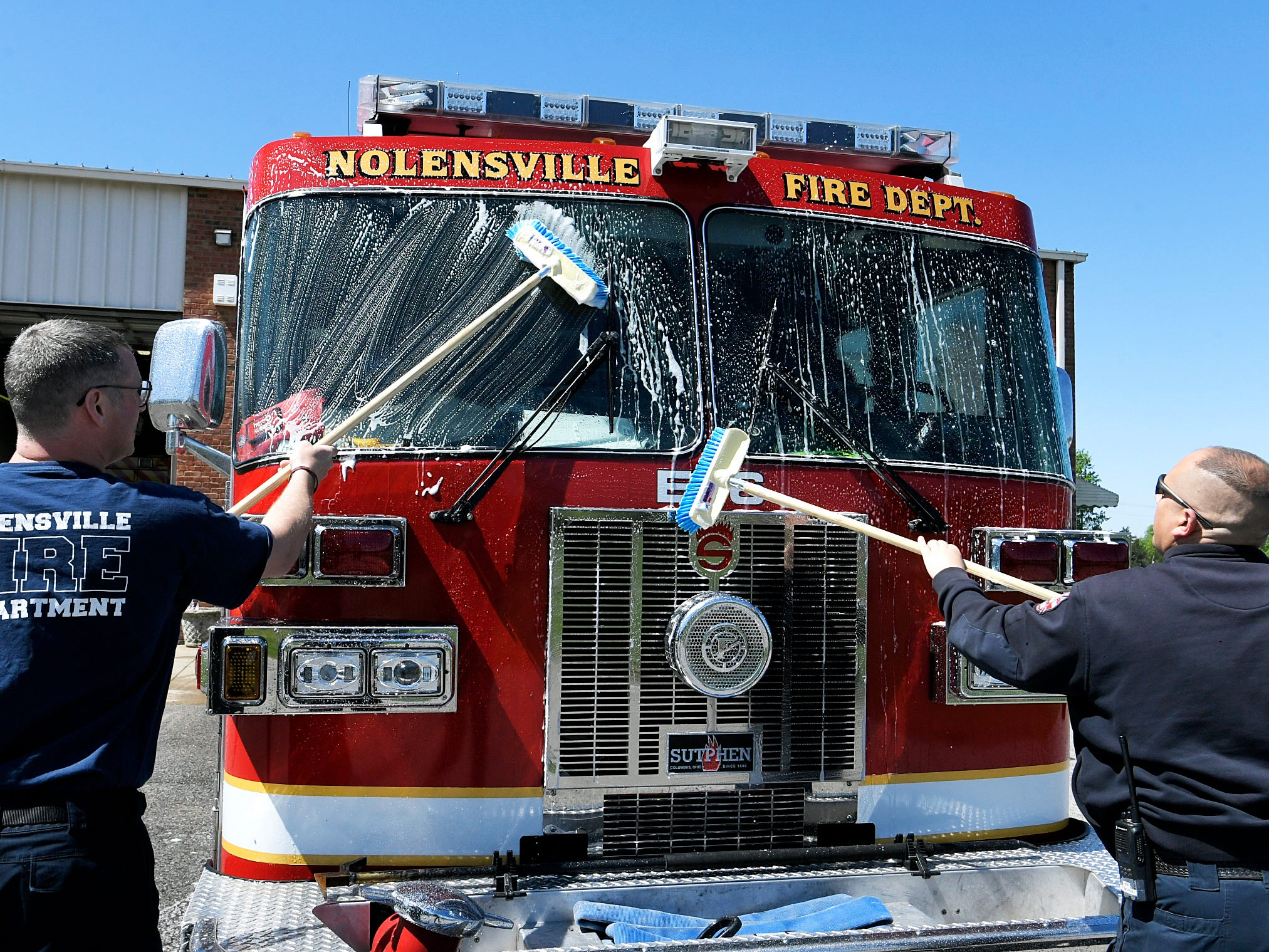 Nolensville Volunteer Fire Department members Daron Standifird, left, and Lt. Troy Murray wash the department's firetruck between calls on Monday, April 15, 2019.