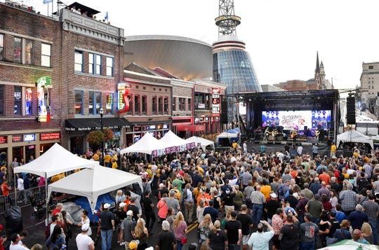 The crowd packs Lower Broadway for the Tootsie's Birthday Bash Oct. 10, 2017 in Nashville.