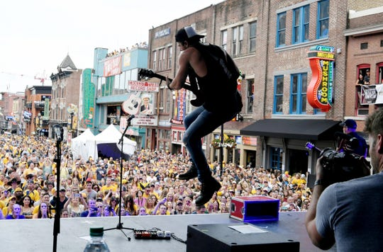 Kip Moore performs on Lower Broadway before Game 4 of the Stanley Cup Final June 5, 2017 in Nashville.