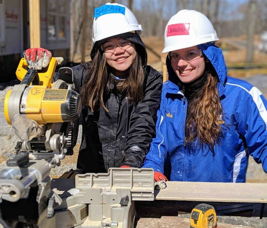 Widener University students Sarah Groete and Claudia Deplato man the saw at the 2019 Habitat High build site. Students from Widener University in Chester, PA and Concordia College in Moorhead, Minnesota traveled to Fairview, TN to spend their spring breaks working on Dowell's home.