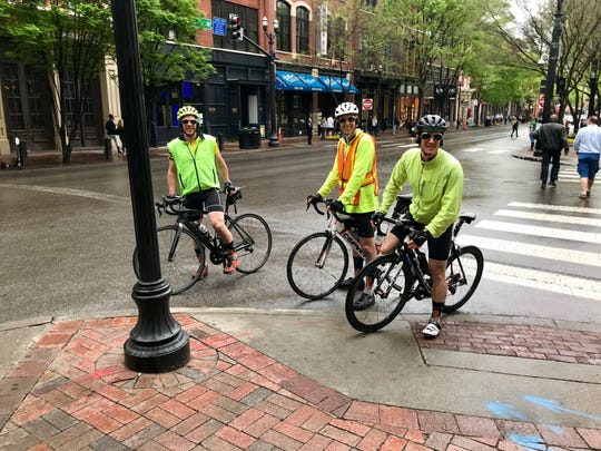 Cyclists Dale Edgerton, Bryan Shepherd and Nick Adams pause on Second Avenue North in the middle of their 100.3-mile ride through Nashville to create Strava art that looks like Elvis playing the guitar.