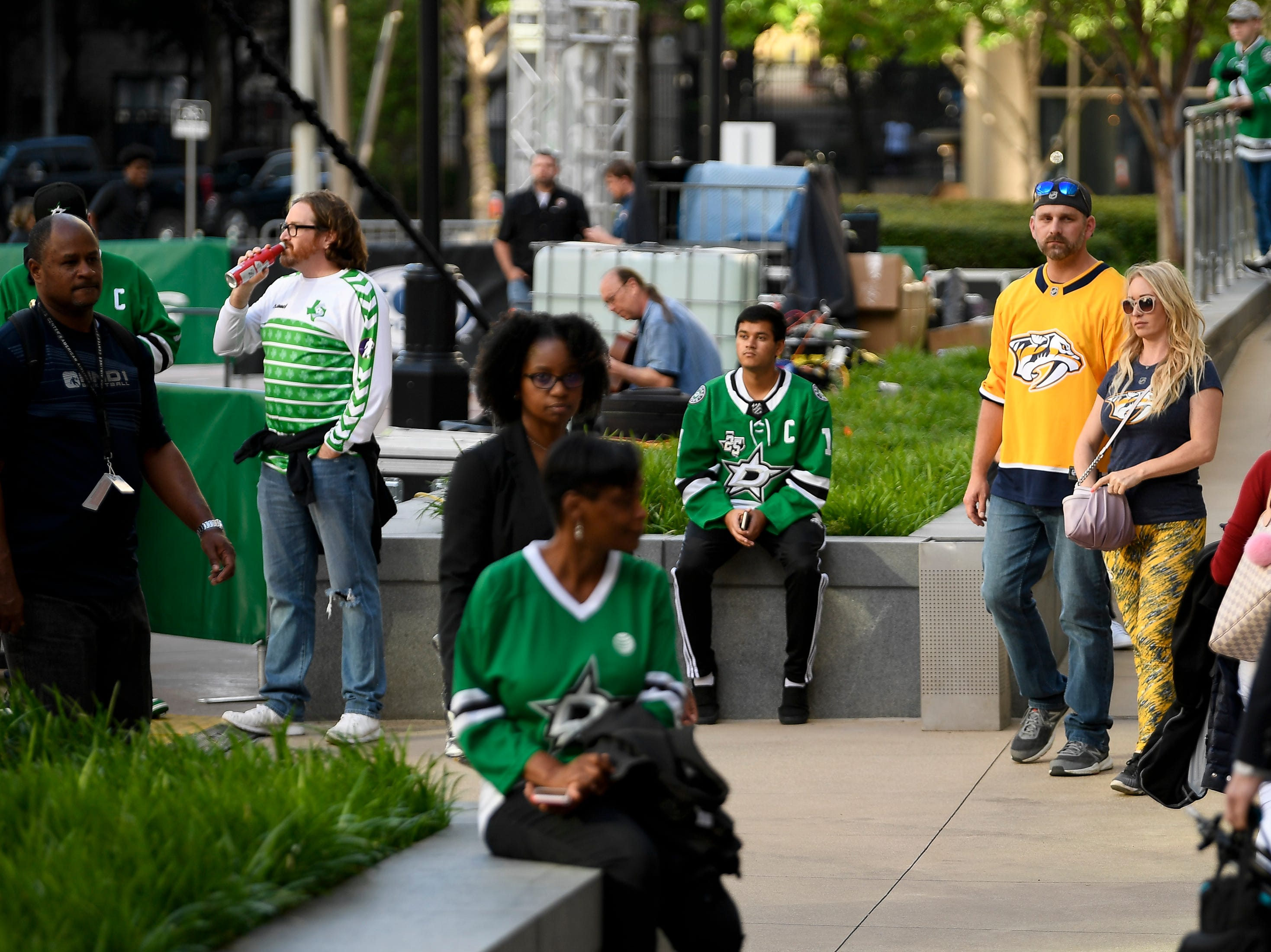Predators fans Adam Jensen and Jennifer Reed, of San Antonio, Texas, arrive surrounded by Stars fans before the divisional semifinal game between the Dallas Stars and the Nashville Predators at the American Airlines Center in Dallas, Texas., Monday, April 15, 2019.