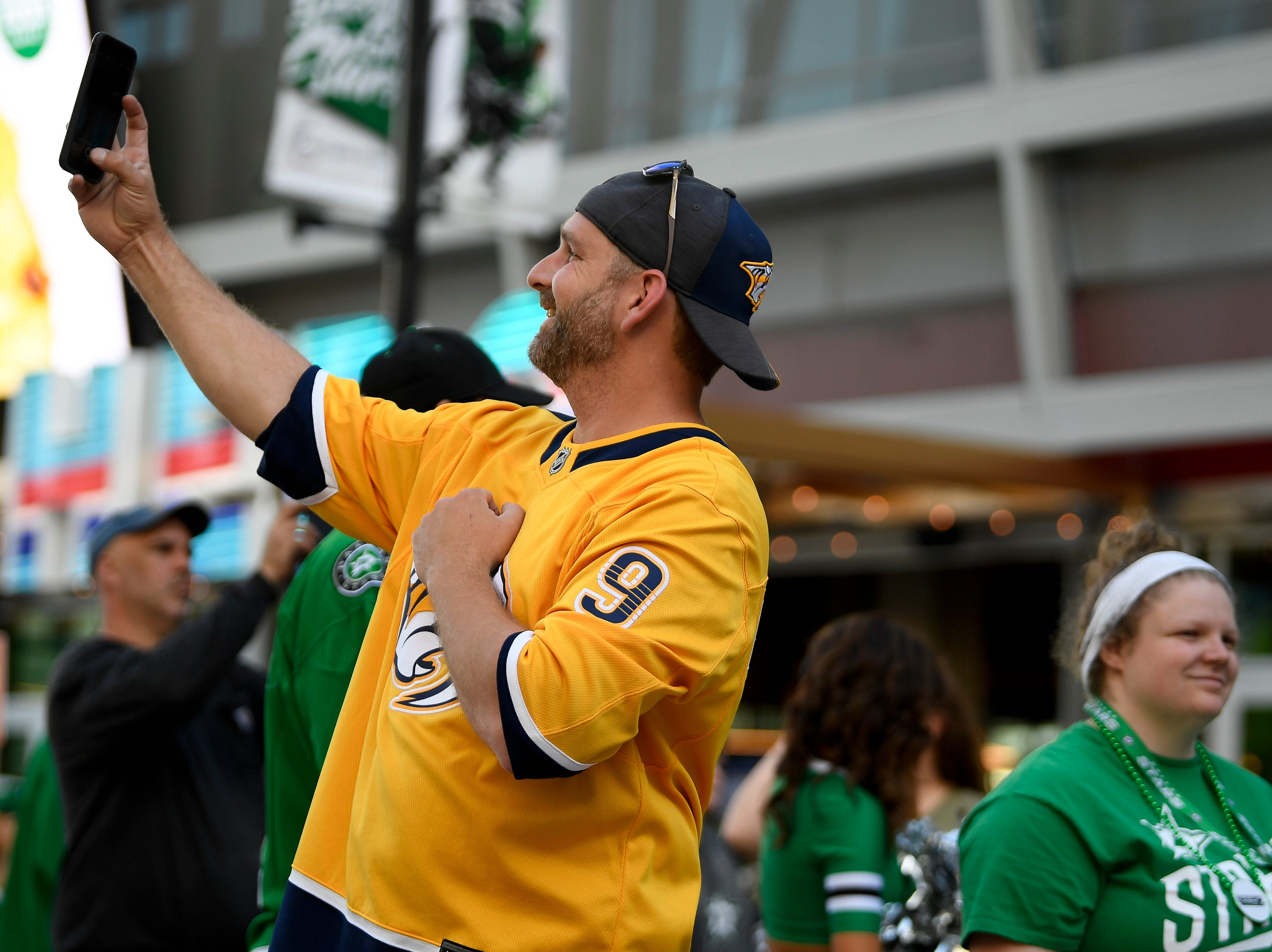 Predators fans Adam Jensen, of San Antionio, Texas, takes a picture before the divisional semifinal game between the Dallas Stars and the Nashville Predators at the American Airlines Center in Dallas, Texas., Monday, April 15, 2019.