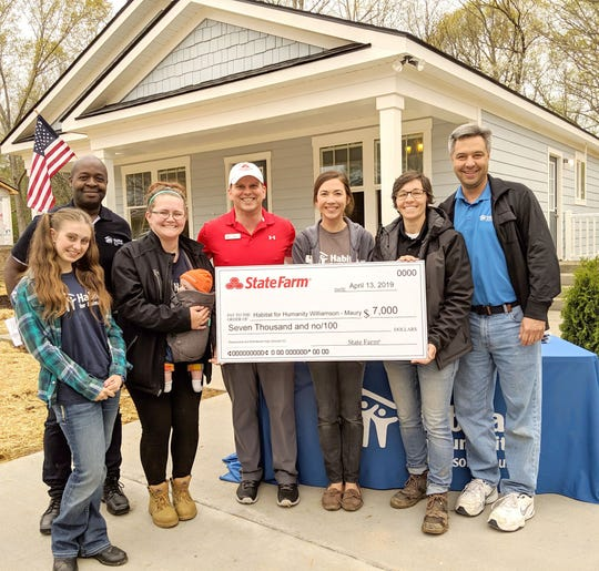 Local Fairview State Farm agent, Joel Moenkhoff, attended the dedication on April 13, 2019, to present the matching State Farm grant check.