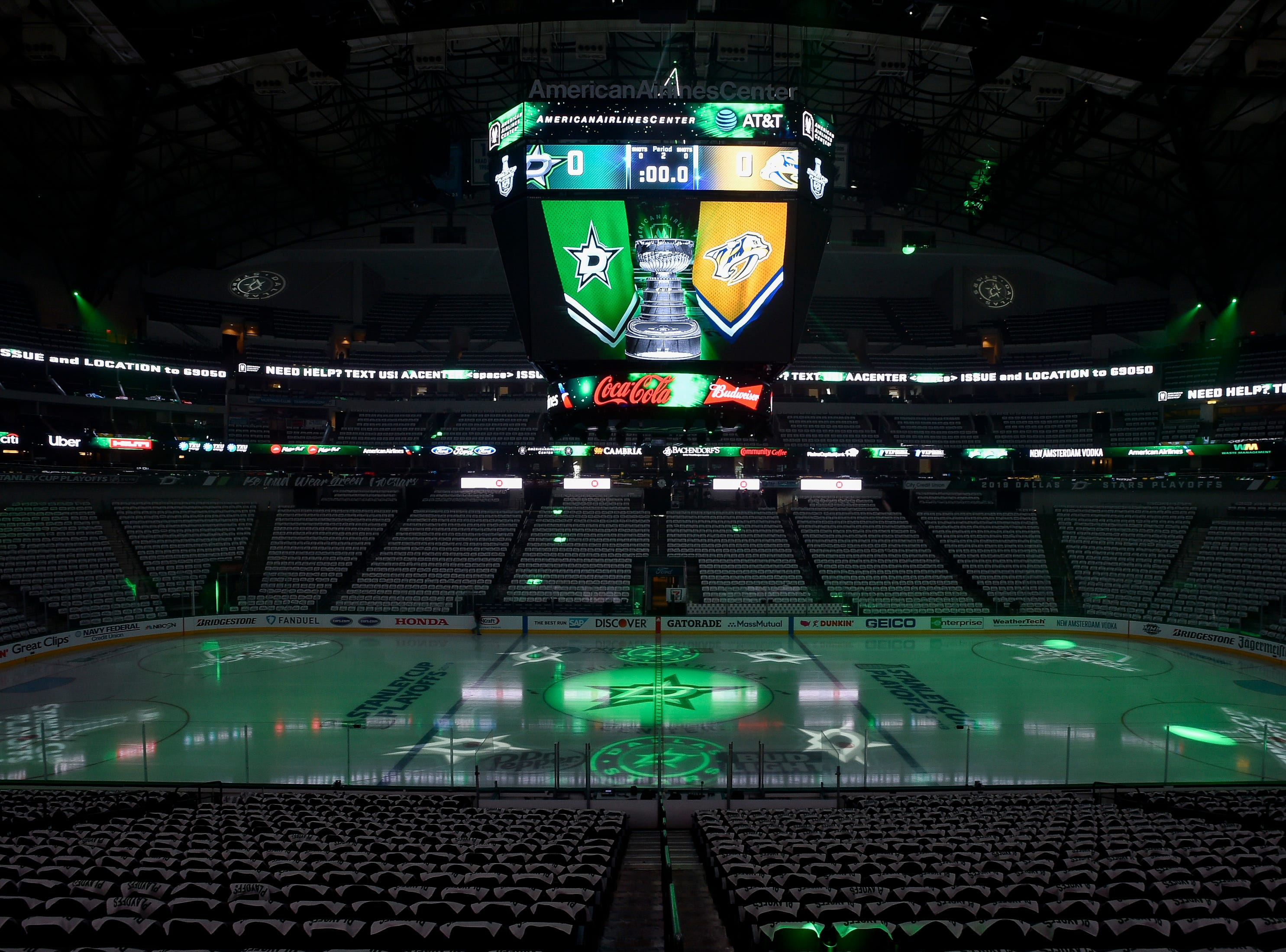 Team flags are seen on the jumbotron before the divisional semifinal game between the Dallas Stars and the Nashville Predators at the American Airlines Center in Dallas, Texas., Monday, April 15, 2019.