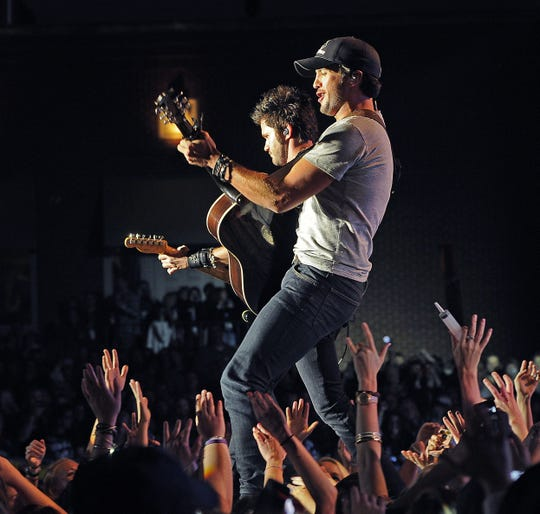 Luke Bryan performs at the Capitol Street Party on Lower Broadway Oct. 17, 2012.