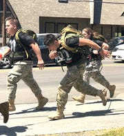 Members of the Fairview High School JROTC sprint for the finish line at the 2018 Mountain Man Memorial March.