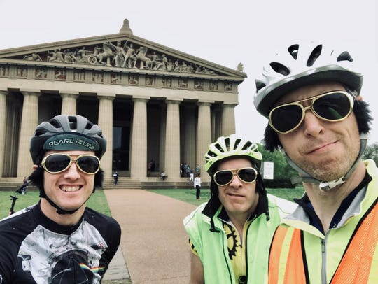 Wearing gold glasses and sideburns, a trio of biology researchers from Vanderbilt University — Nick Adams, left, Dale Edgerton, center, and Bryan Shepherd — rode through Nashville to create Strava art that looks like Elvis playing the guitar. Midway through the 100.3-mile ride they posed in front of the Parthenon in Centennial Park.