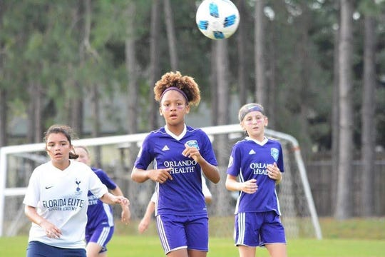 Azzurri Storm's Angeyla Burberry and Hayden Bluestein give chase during the U11 state semifinal game against Florida Elite from Jacksonville.