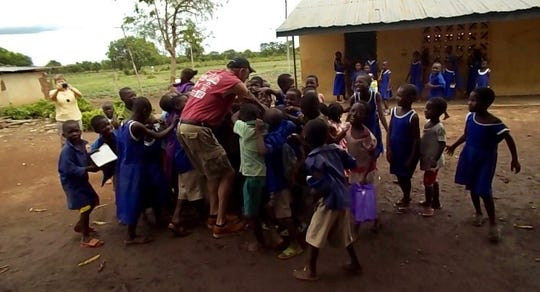 Brian Hall in village Kalande meeting children from a local school.