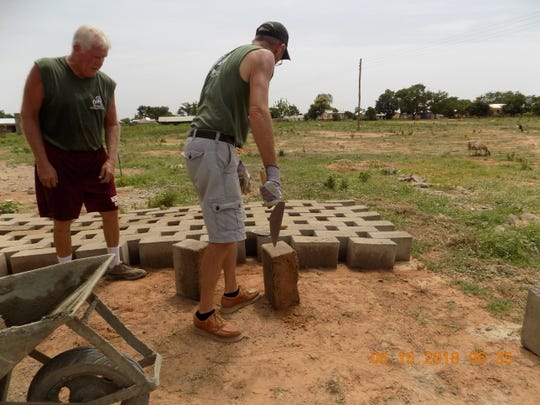 Members of Marne United Methodist team build cement blocks by hand for a water cistern in Ghana.