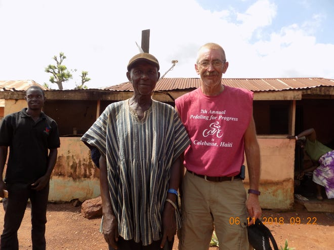 Brian Hall in a Ghanaian village with  Marne United Methodist's last trip to Ghana.