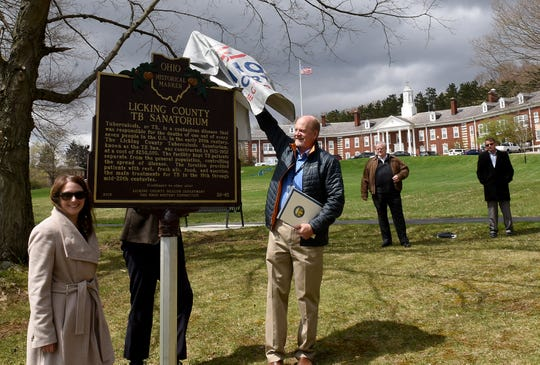 Licking County Health Commissioner Joe Ebel unveils a historical marker last year in front of the Licking County Health Department recognizing the Licking County Tuberculosis Sanatorium, which had been located at the Price Road building before the health department.