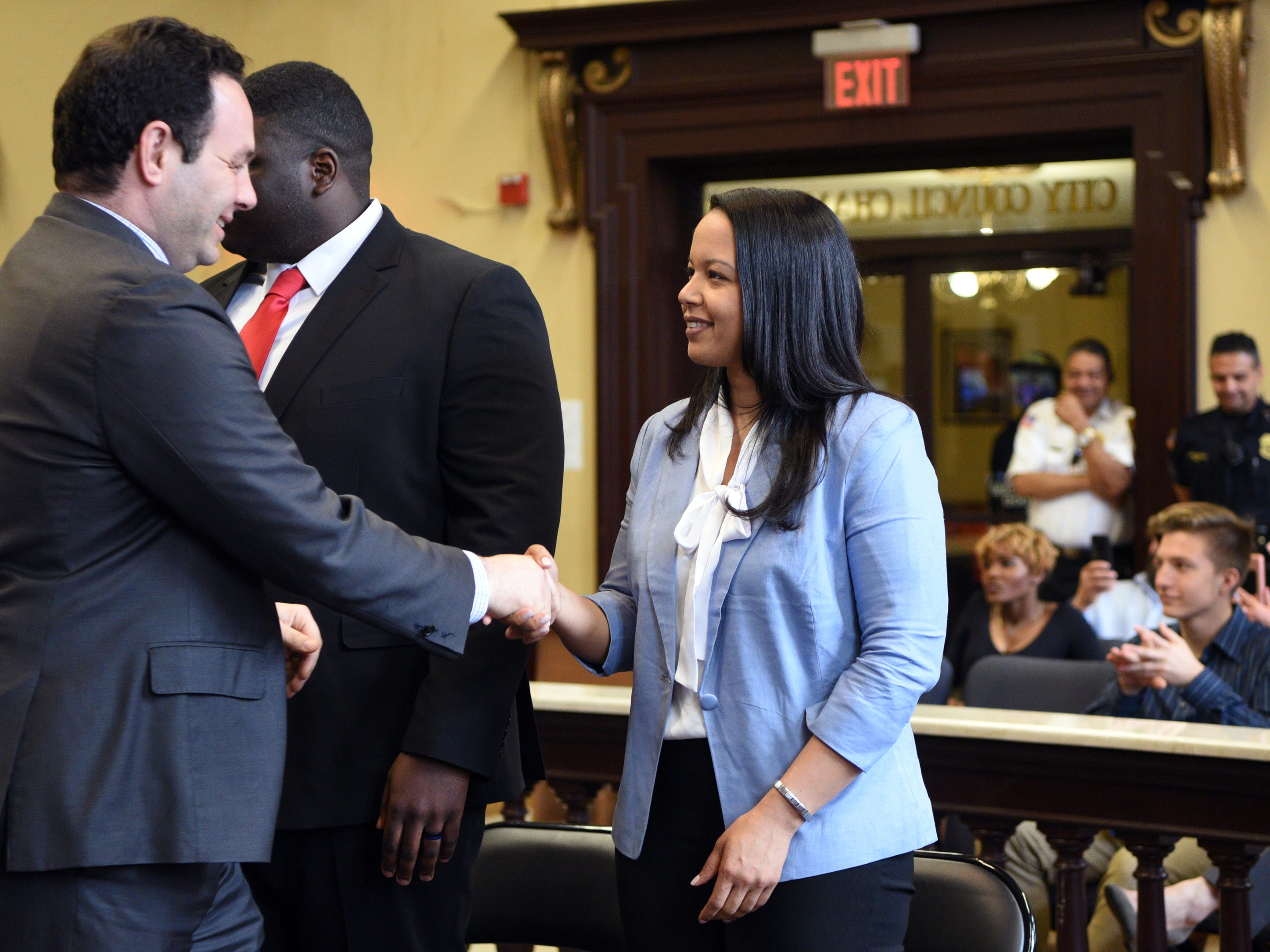 Paterson Mayor Andre Sayegh congratulates Yoanna Pratt-Perez, on of eight new Paterson police officers sworn during a ceremony at Paterson City Hall on Monday, April 14, 2019.