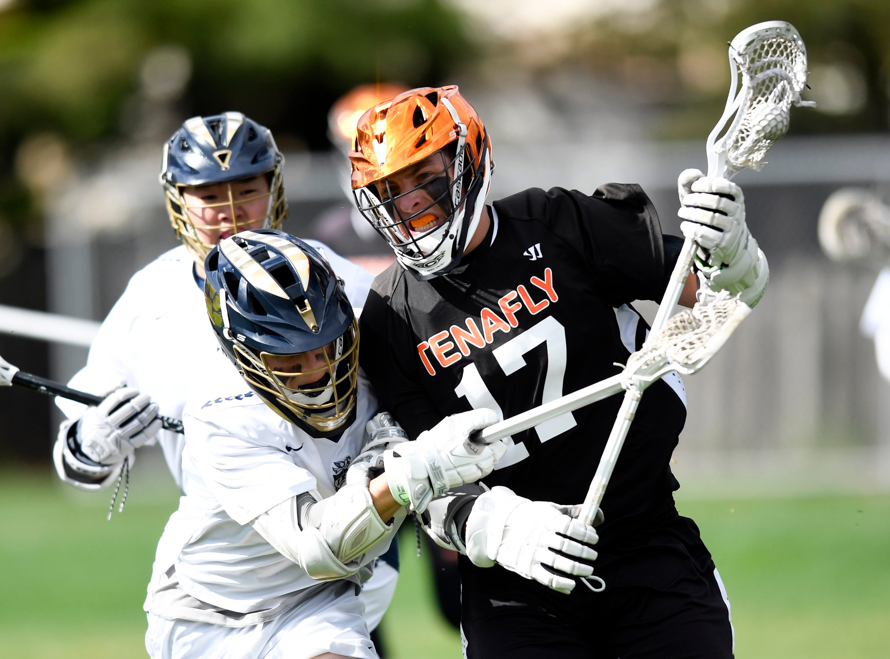 Dwight Englewood's Brian Winters, left, collides into Tenafly's Jeremy Abramowitz on Monday, April 15, 2019, in Englewood.