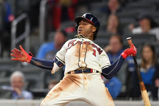 Apr 14, 2019; Atlanta, GA, USA; Atlanta Braves second baseman Ozzie Albies (1) gets out of the way of an inside pitch against the New York Mets during the fourth inning at SunTrust Park.