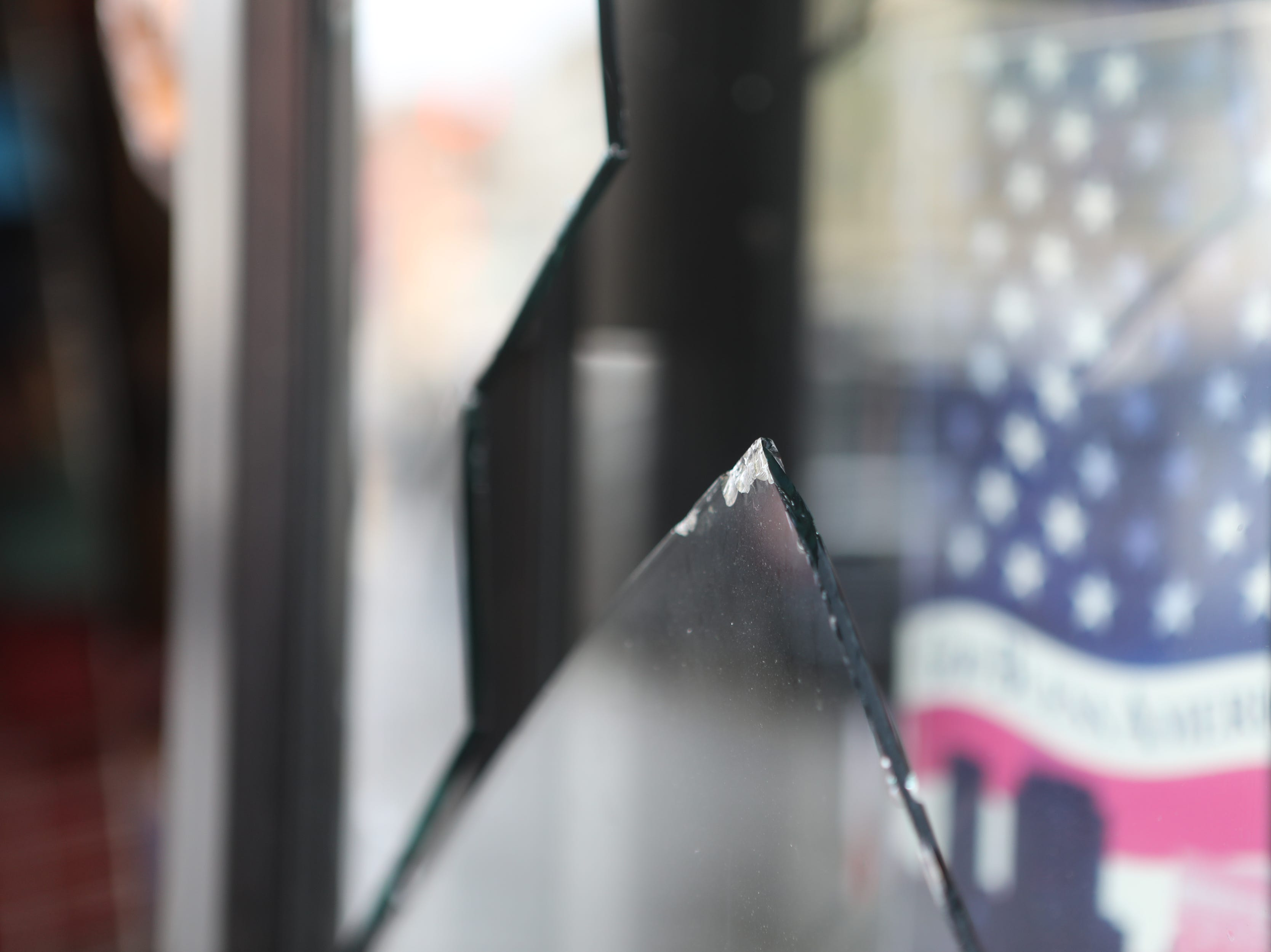 A glass door broke at City Fashion, in Paterson, after the power of the wind blew it open. Monday, April, 15, 2019