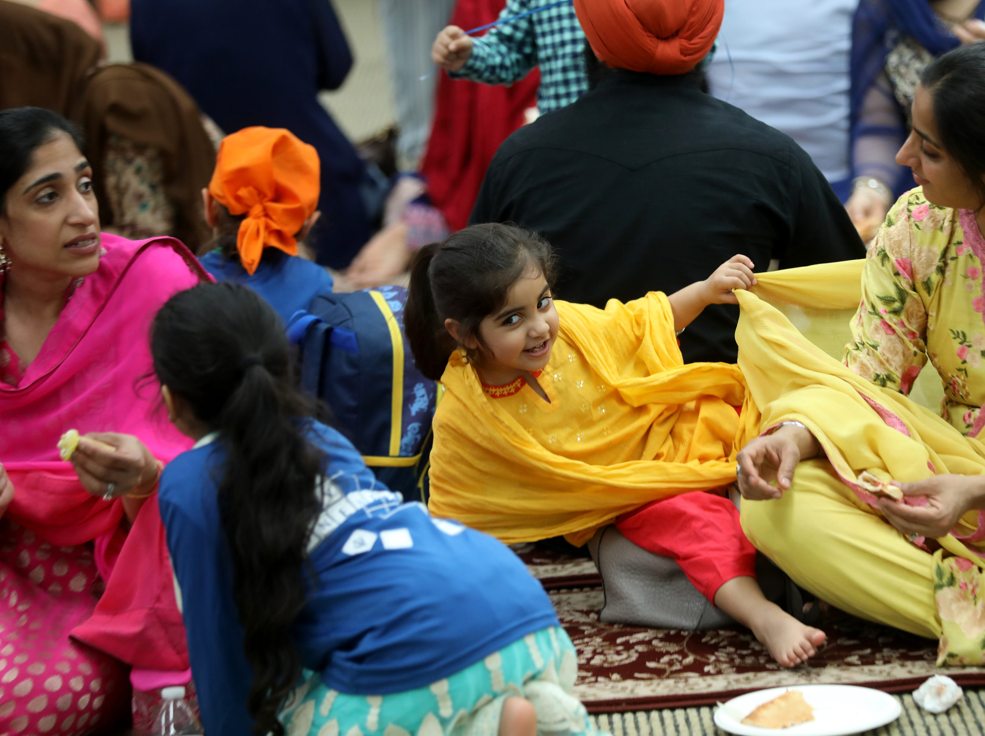 Mehma Kaur (almost 3), and her mother, Manpreet Kaur, , both of Franklin Lakes, are shown during lunch time at Guru Nanak Mission, in Oakland. Sunday, April, 14, 2019