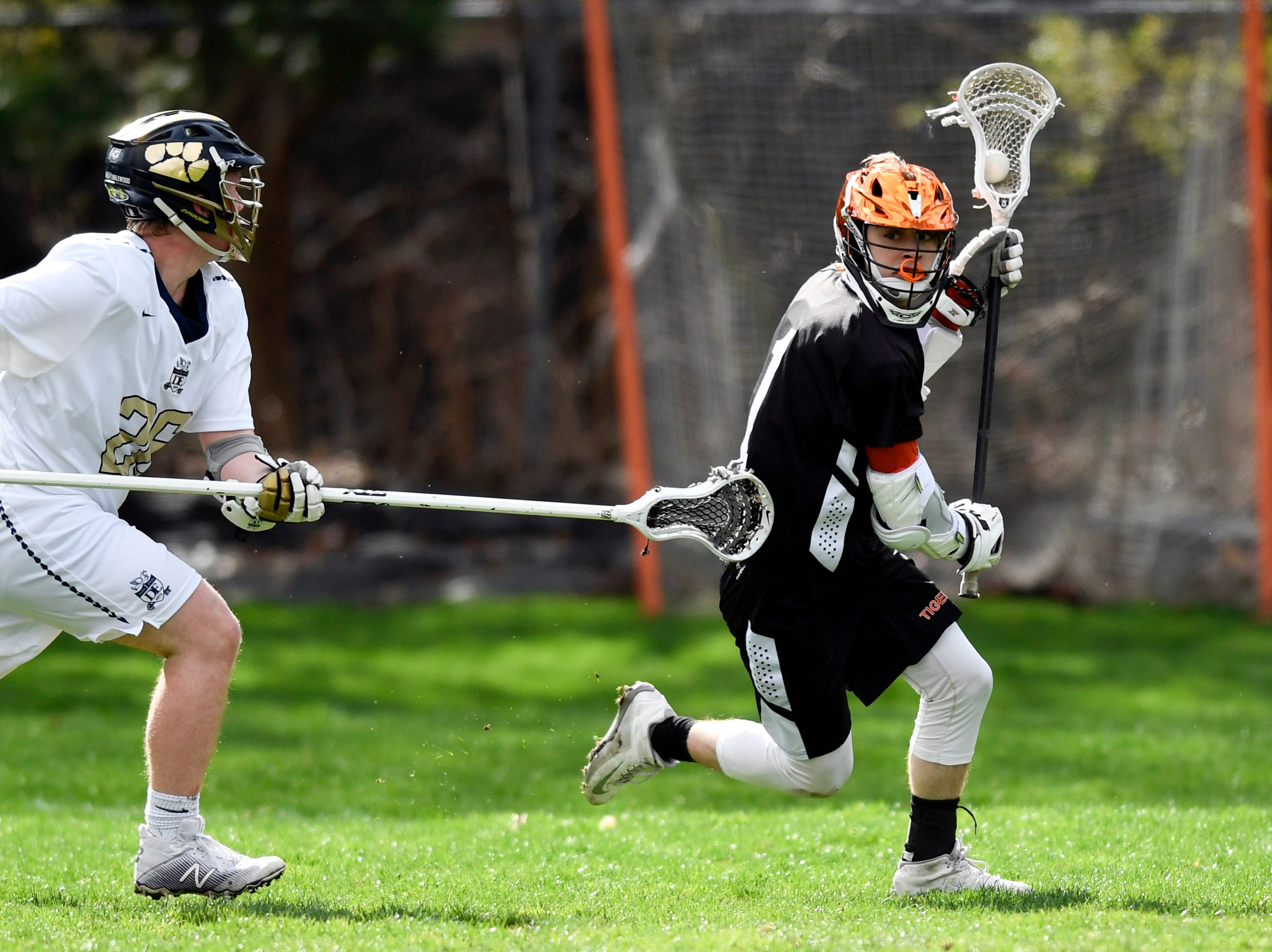 Tenafly's Austin Dome, right, and the Tigers face Dwight Englewood on Monday, April 15, 2019, in Englewood.