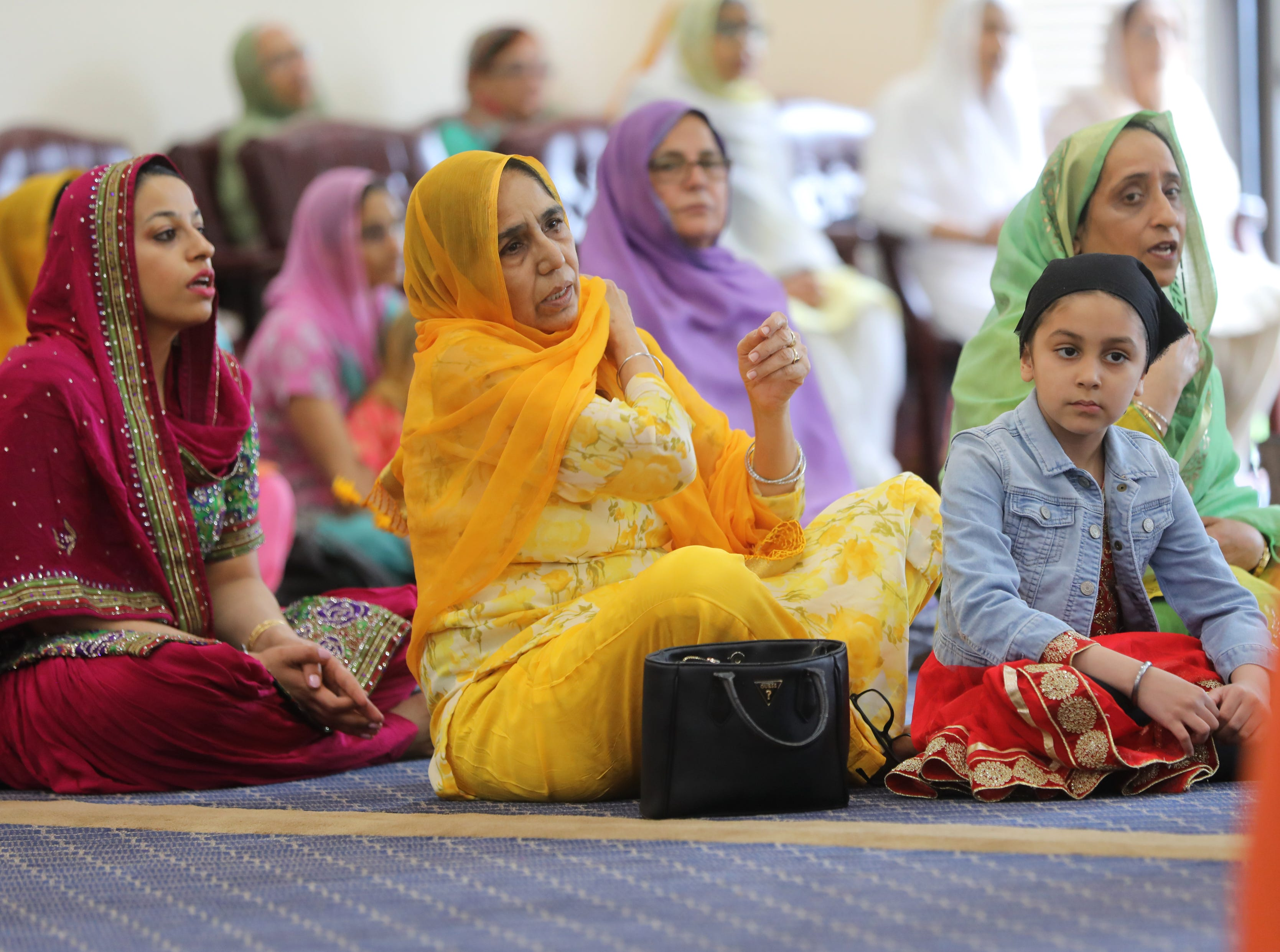 Surjid Kaur and her grandaughter, Kudrhe Kaur, 5, are shown in the main hall. Sunday, April, 14, 2019