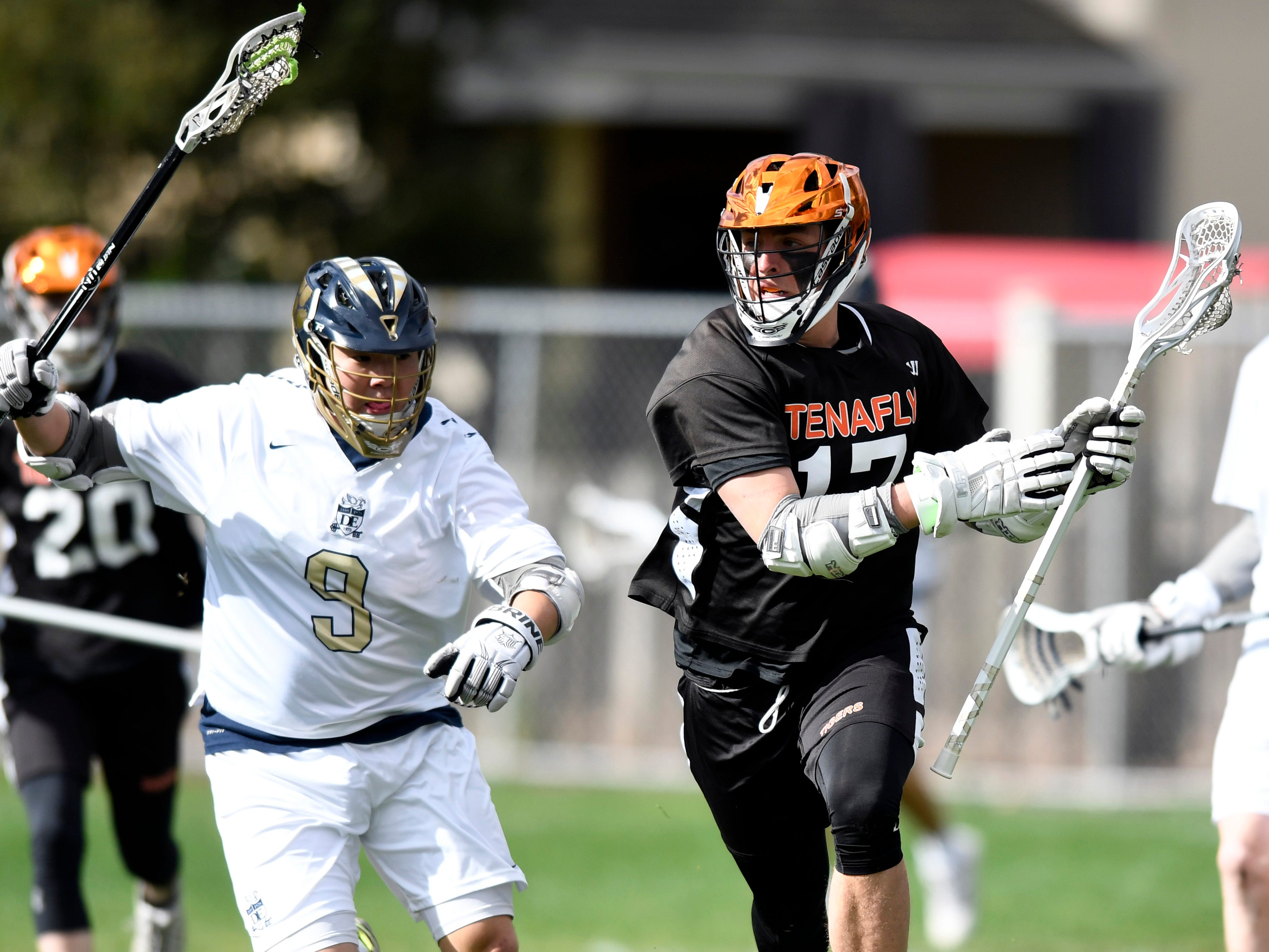 Tenafly's Jeremy Abramowitz, right, runs with pressure from Dwight-Englewood's Matt Park on Monday, April 15, 2019, in Englewood.