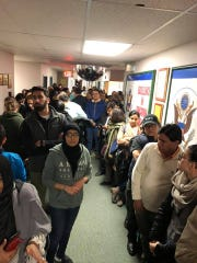 Hundreds of people showed up an East Brunswick Board of Education meeting on April 11, one day after a Muslim student was punched and had her hijab ripped from her head.
