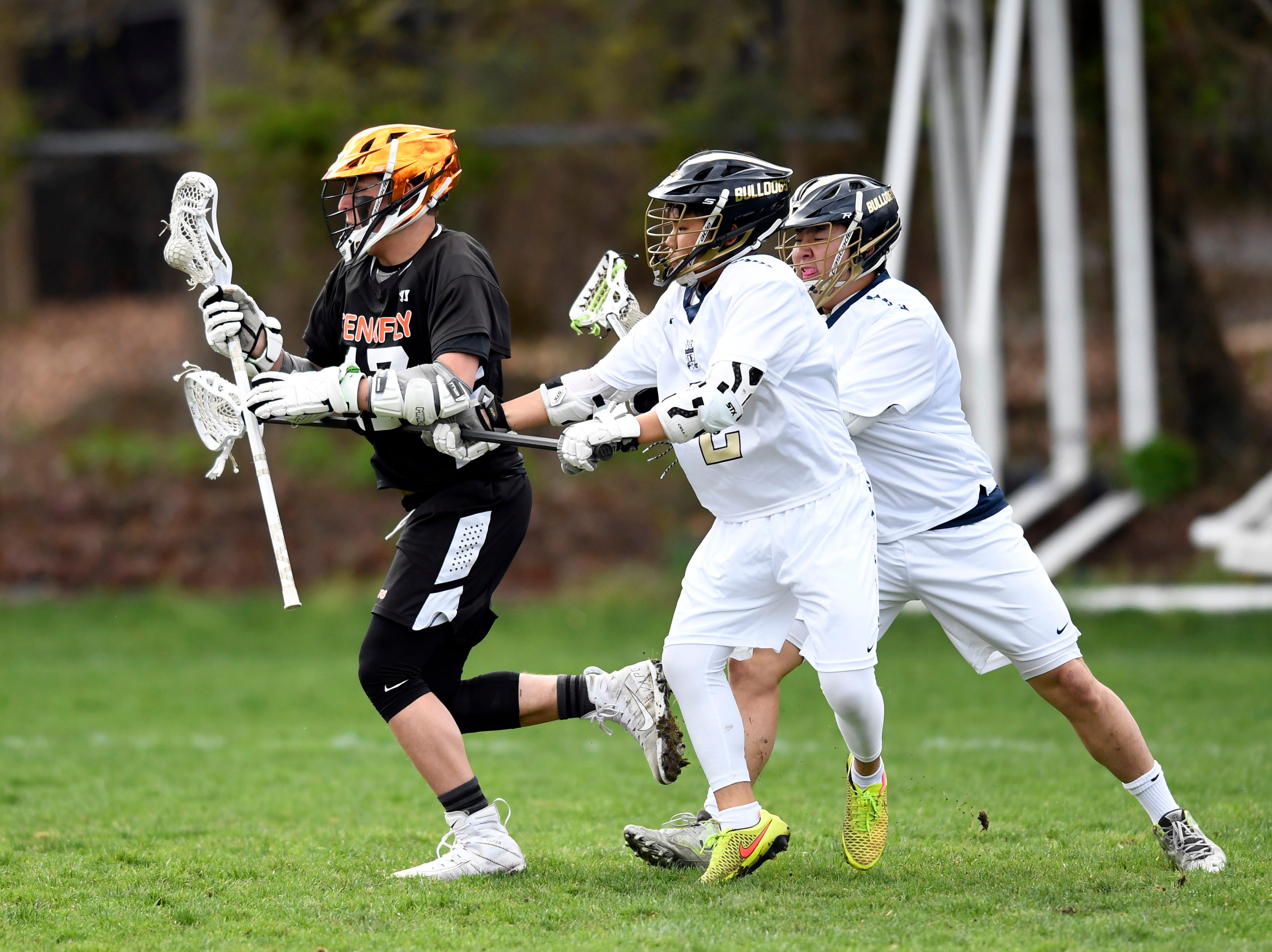 Tenafly's Jeremy Abramowitz, far left, drives to the net with pressure from Dwight-Englewood defenders on Monday, April 15, 2019, in Englewood.