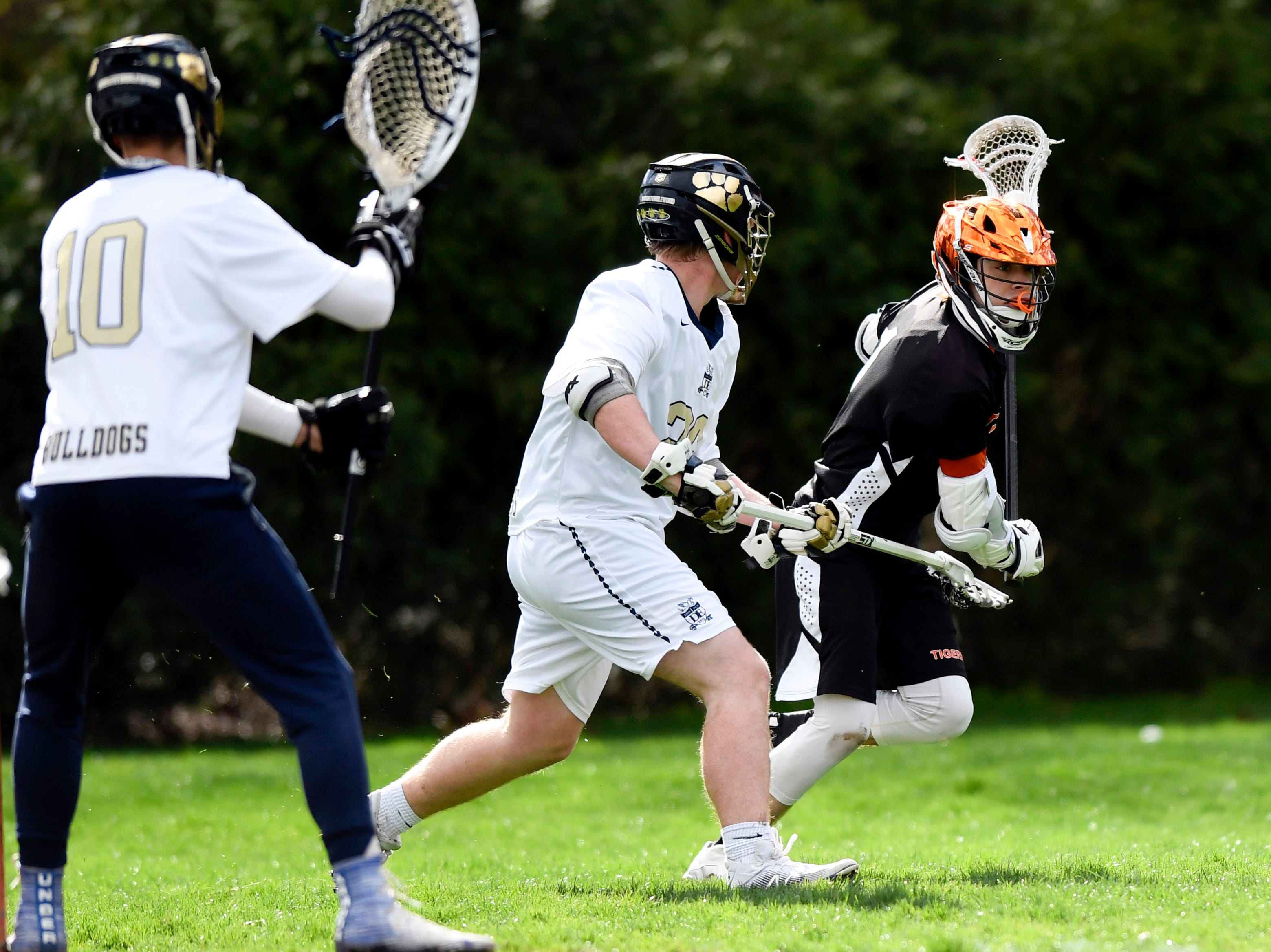 Tenafly's Austin Dome, far right, looks for a hole in the Dwight Englewood defense on Monday, April 15, 2019, in Englewood.
