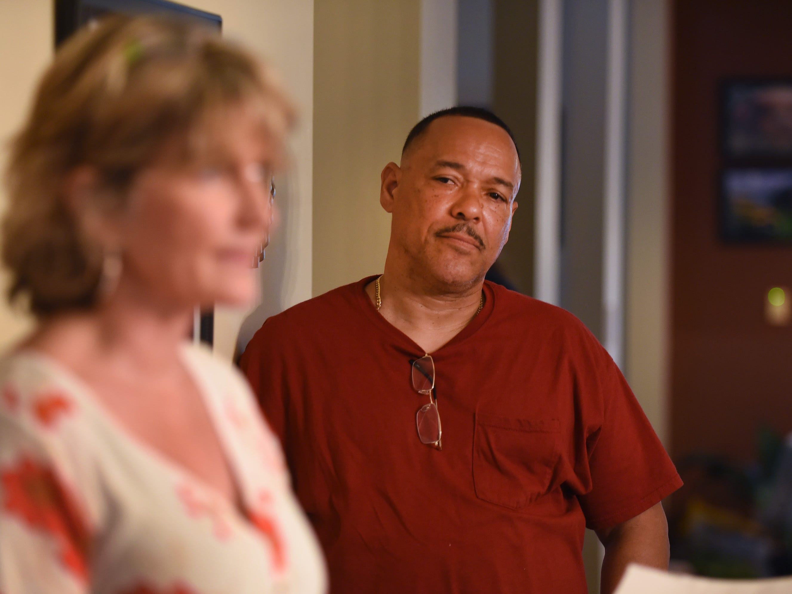 Cisco Sanchez (age 57) of Paterson, who is recovering from drug and alcohol addiction, listens as Nancy Labov (foreground), the Founder and Director of AIR(Alumni in Recovery), speaks to its members, family members of those who died from addiction,and volunteers, during their annual community meeting in Old Tappan on 04/14/19.