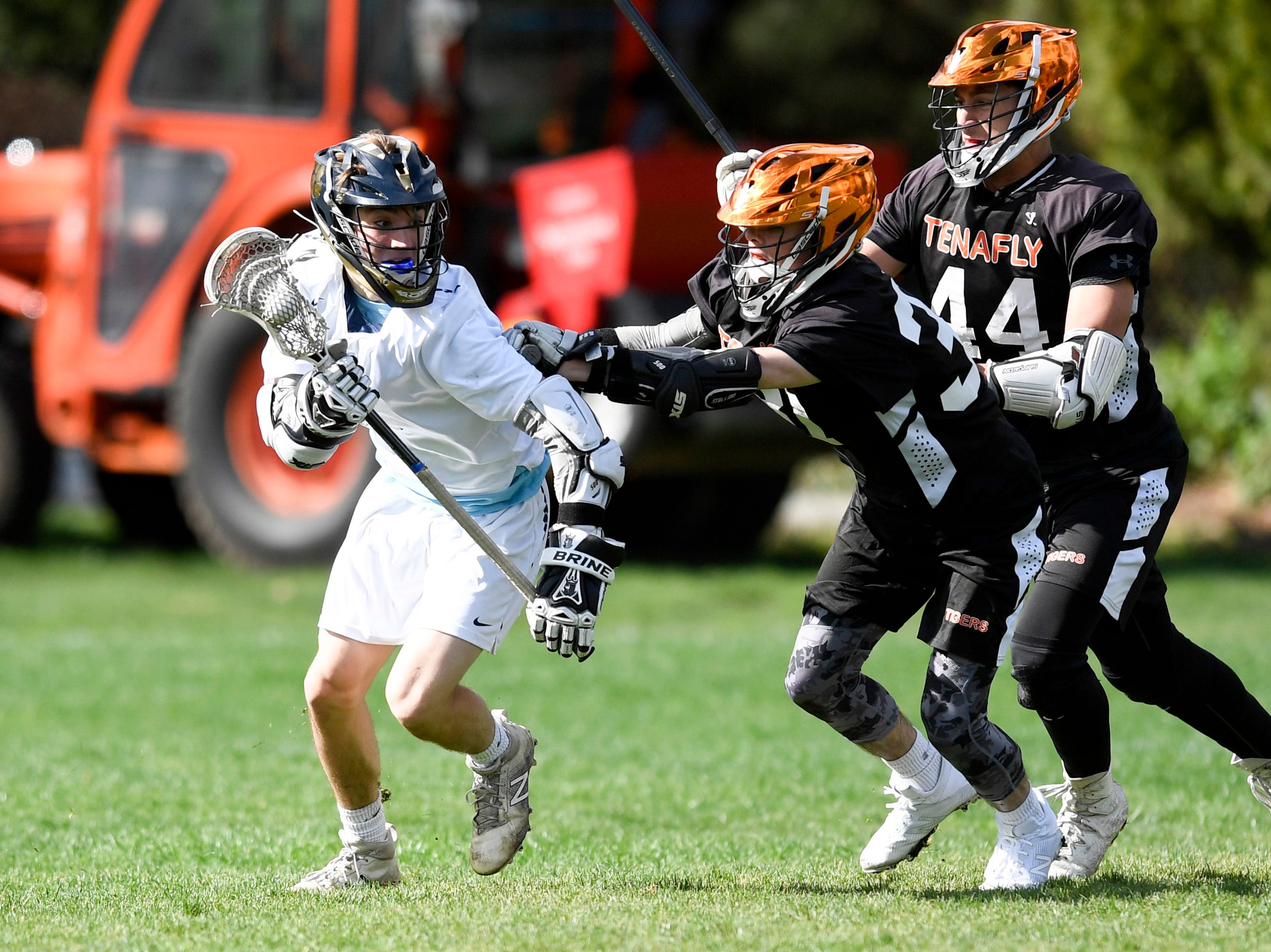 Dwight Englewood's Gavin Malhame, left, faces pressure from Tenafly defenders on Monday, April 15, 2019, in Englewood.