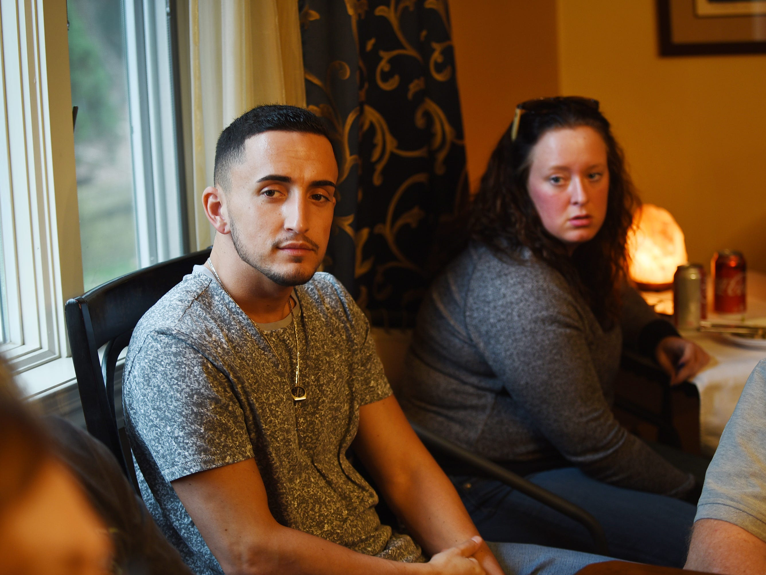 Joseph DeGregorio of Nutley (age 25) who is recovering from drug and alcohol addiction, and Erin Conaughton (age 28) of Teaneck who is recovering from drug addiction, listens as Nancy Labov, the Founder and Director of AIR(Alumni in Recovery), speaks to its members, family members of those who died from addiction,and volunteers, during their annual community meeting in Old Tappan on 04/14/19.