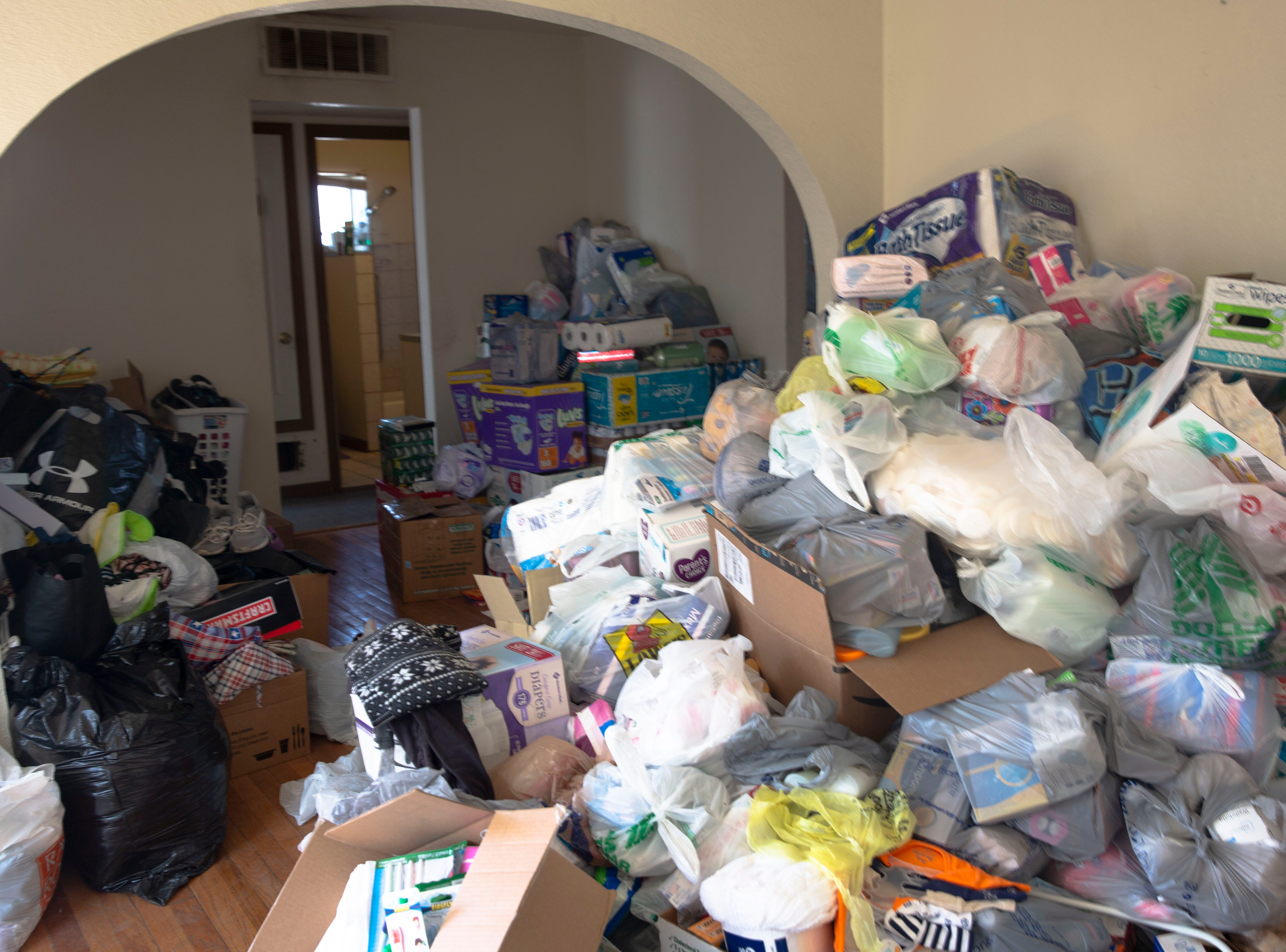 A home on the Las Cruces Gospel Rescue Mission's property is being used to hold donations from the community for migrant families who have been dropped off by Border Patrol in Las Cruces. Shown here are bags of donated items on Monday April 15, 2019.