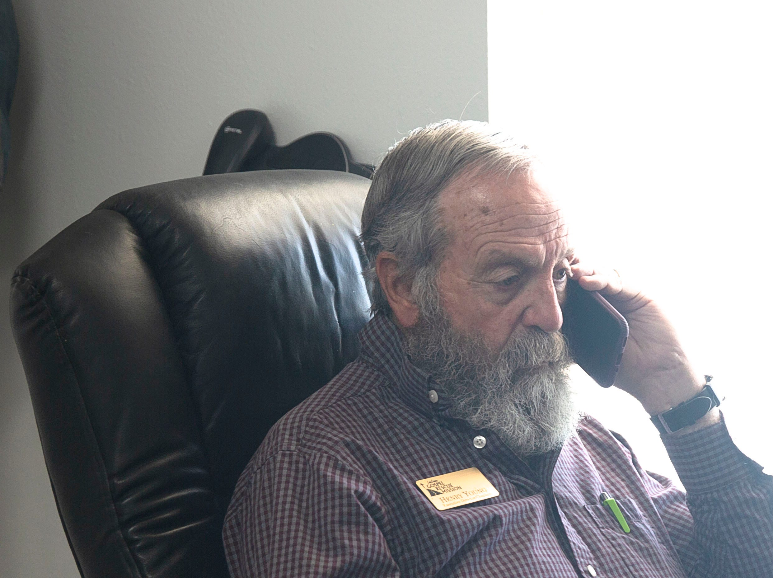 Henry Young, executive director and chaplain at the Las Cruces Gospel Rescue Mission, calls for medical help Monday April 15, 2019.