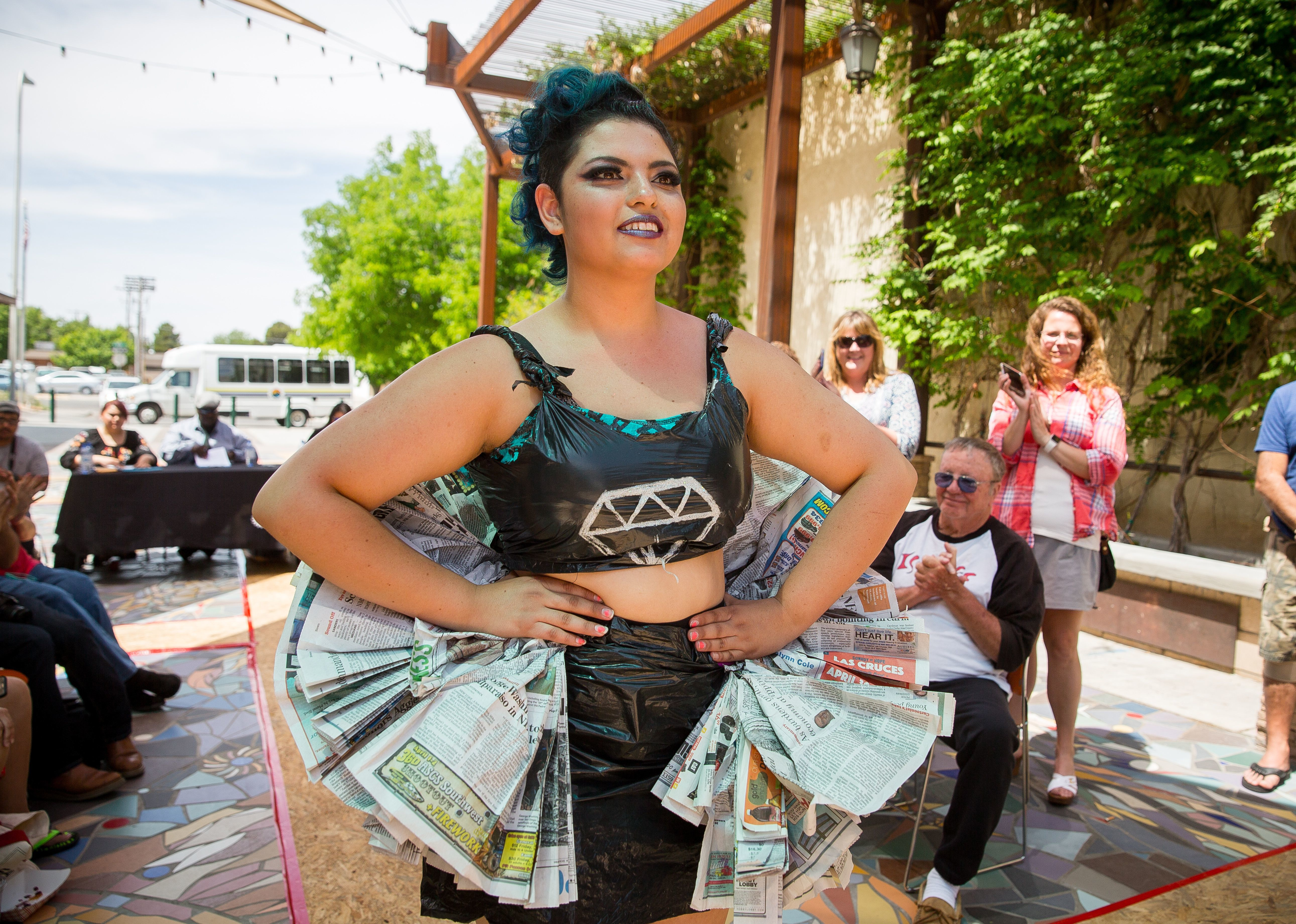 """Elaine Cuaron, dressed as a """"punk rock ballerina"""" in an outfit made from recycled materials, struts a temporary catwalk in La Placita off of Main Street as part of Keep Las Cruces Beautiful's fourth annual Reuse & Recycle Fashion Show in honor of Earth Day."""