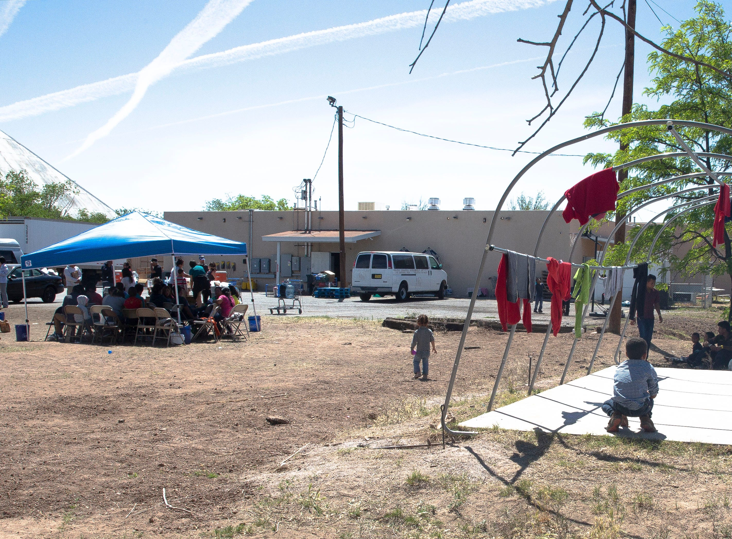 Migrant families and children wait for the next step of their journey Monday April 15, 2019, at the Gospel Rescue Mission in Las Cruces.